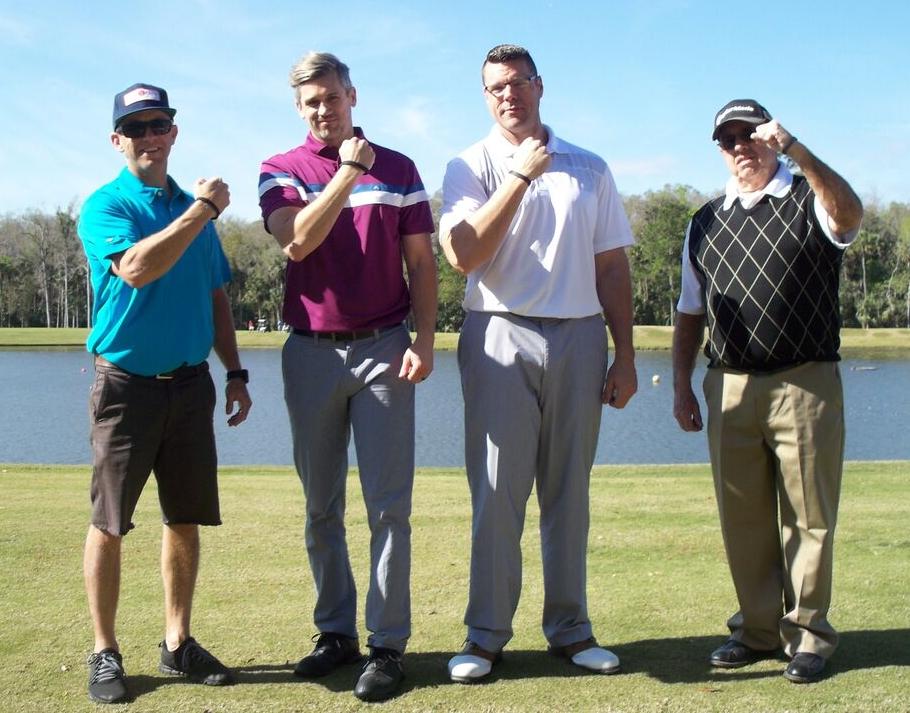 aaron golfing.jpg