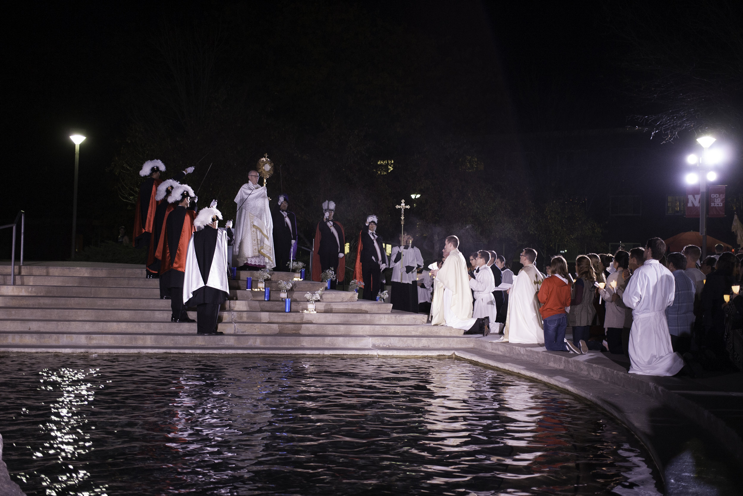 Bishop Conley holds the Eucharist by the Broyhill Fountain on the Nebraska Union Plaza as part of the Newman Center's annual Eucharistic Procession.