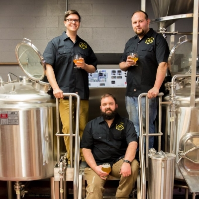 Brian Bugnacki (left), Mike Larson (right) and Chris DeGasero (seated), of Alvarium Beer Company