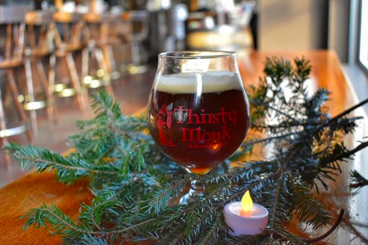 The much beloved, original Thirsty Monk brewpub serves up many beers to warm you up during the holidays.