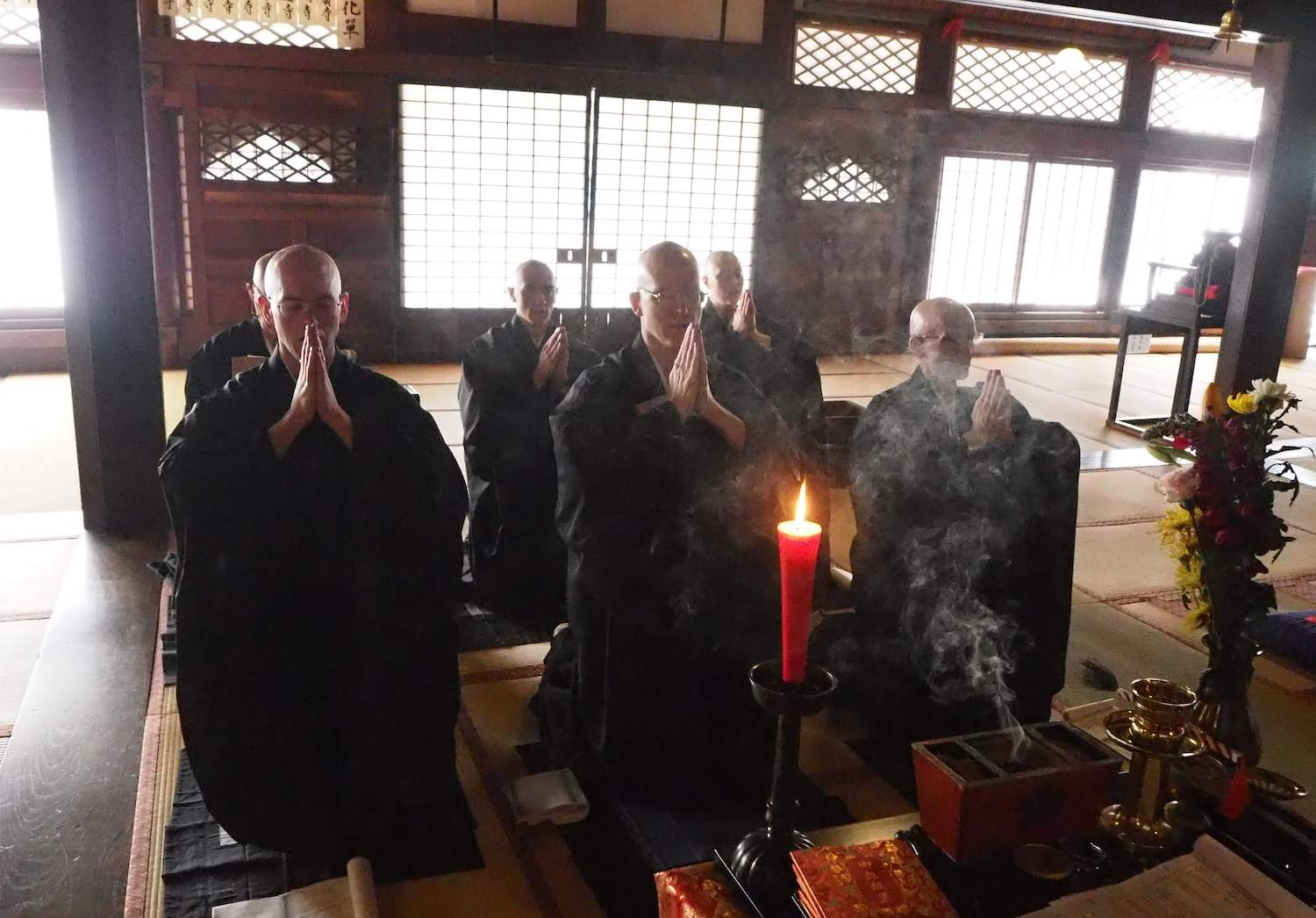 Burning incense before receiving the lineage documents.