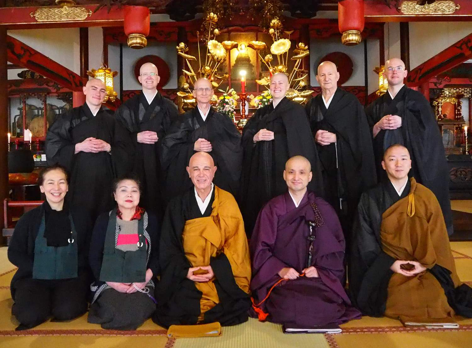 Sangha participating in and supporting the ceremony.