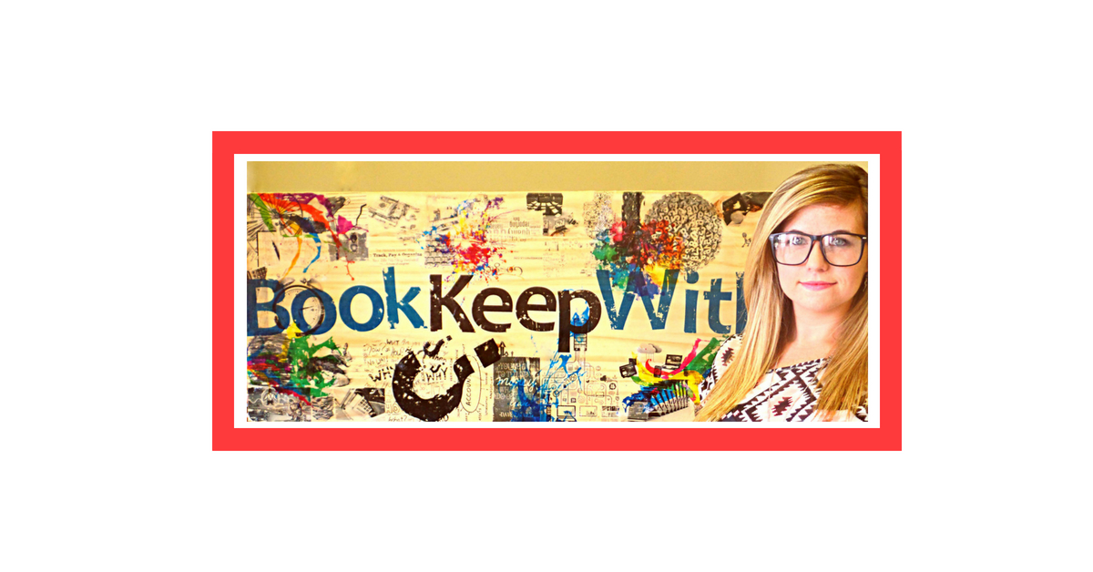 Girl with glasses standing in front of the bokkeepwithus board