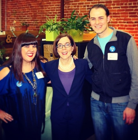 DEVON WORKED TO HELP PASS THE CLEAN FUELS STANDARD, A KEY LAW to reduce OREGON'S CLIMATE FOOTPRINT.PICTURED HERE CELEBRATING THE LAW'S PASSAGE WITH HER HUSBAND, BRYCE, AND GOVERNOR KATE BROWN.