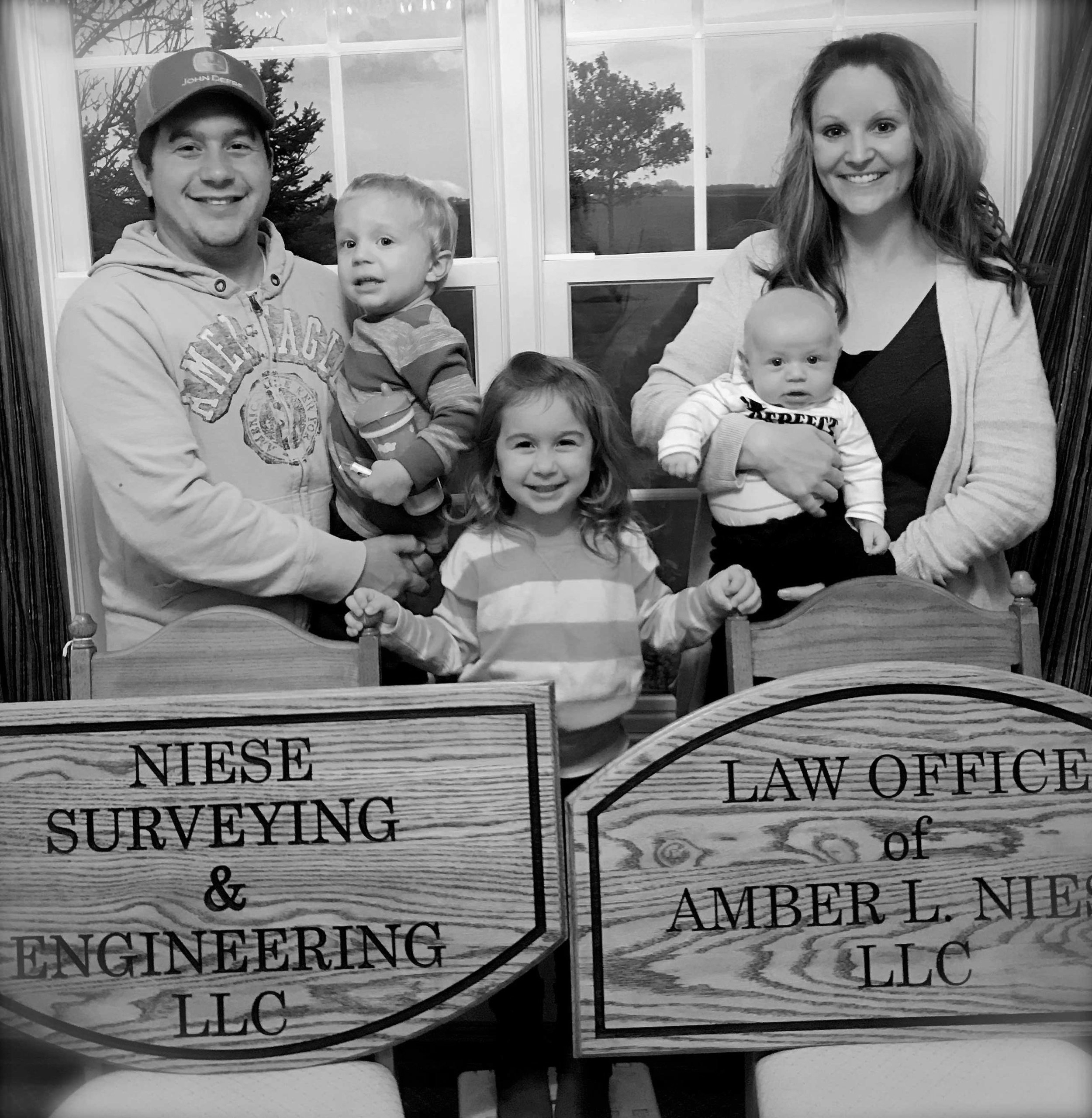 Amber Niese and family with the Miller City location signs