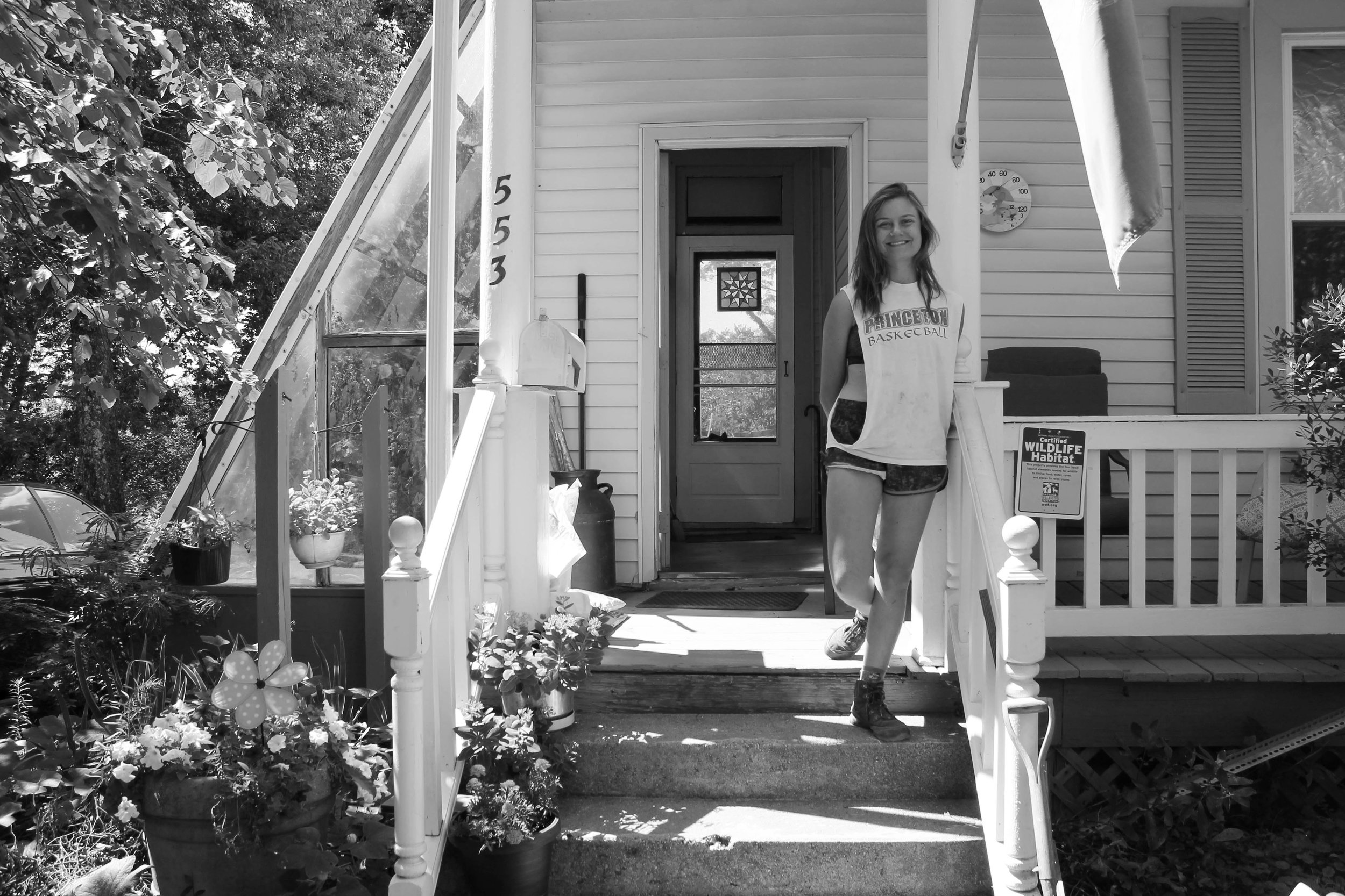 Leah Rutz stands in front of her house.