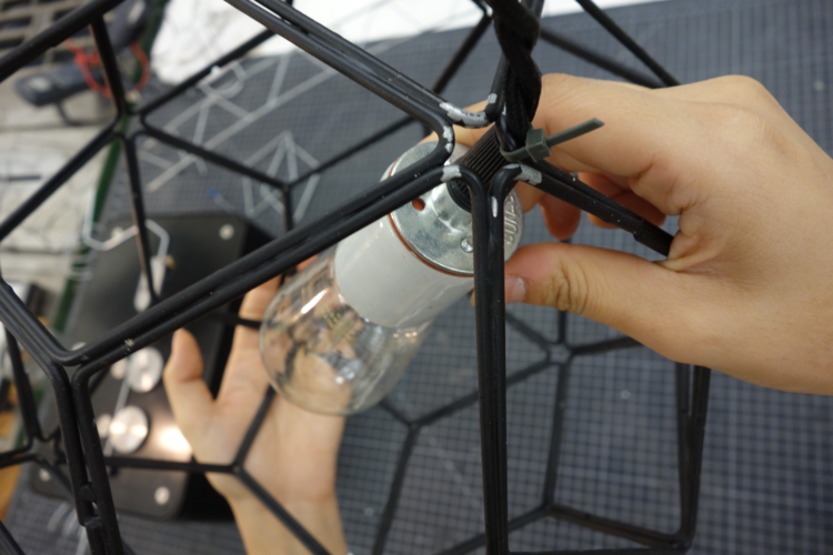 We used a zip tie to attach the light's cord to the structure.