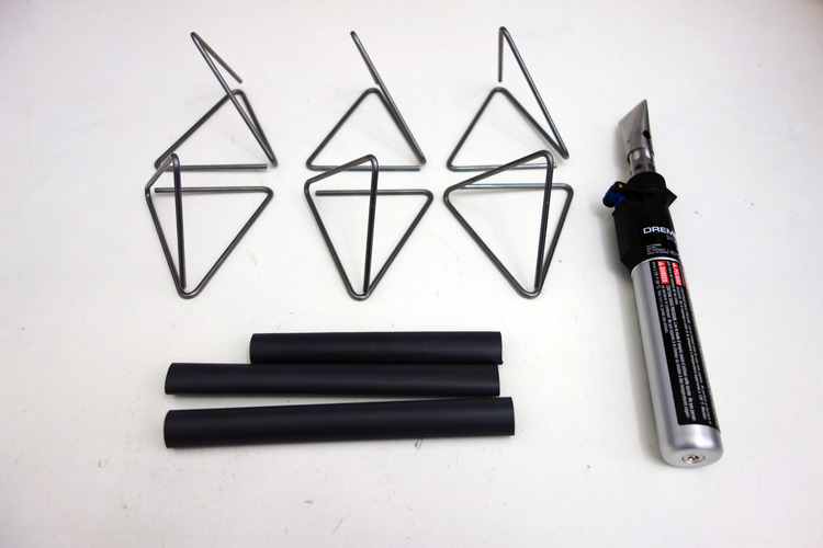 You'll end up with this tetrahedral shape. Repeat six times and get out the heat shrink.