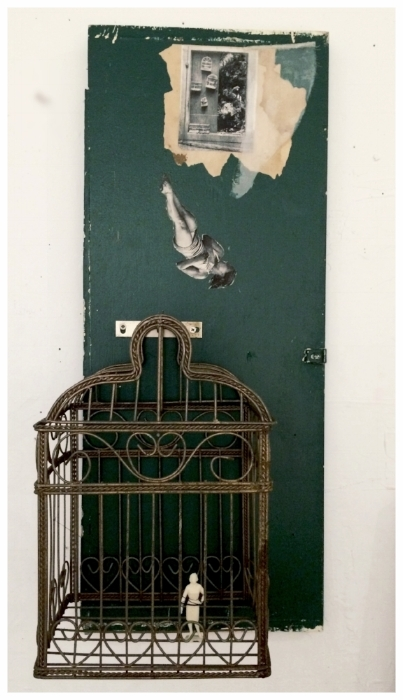 Cage,  collage/assemblage on wood with found bird cage