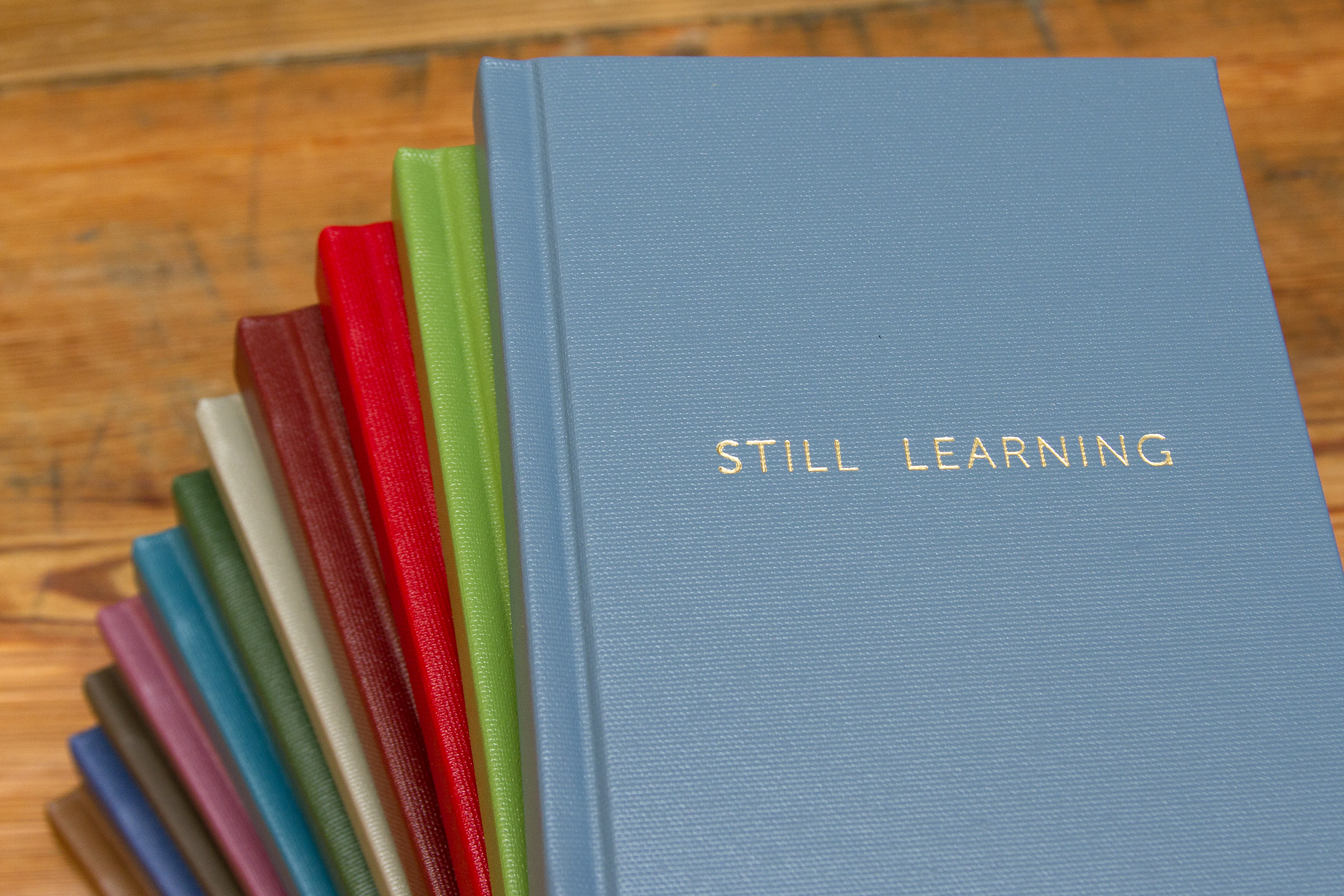 STILL LEARNING daily planners made by Candor Arts. Photo courtesy of Candor Arts.