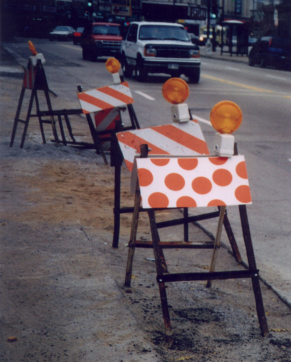 Proceeding with Caution 1 , 1998. Documentation photo of screen print attached to existing barricade.
