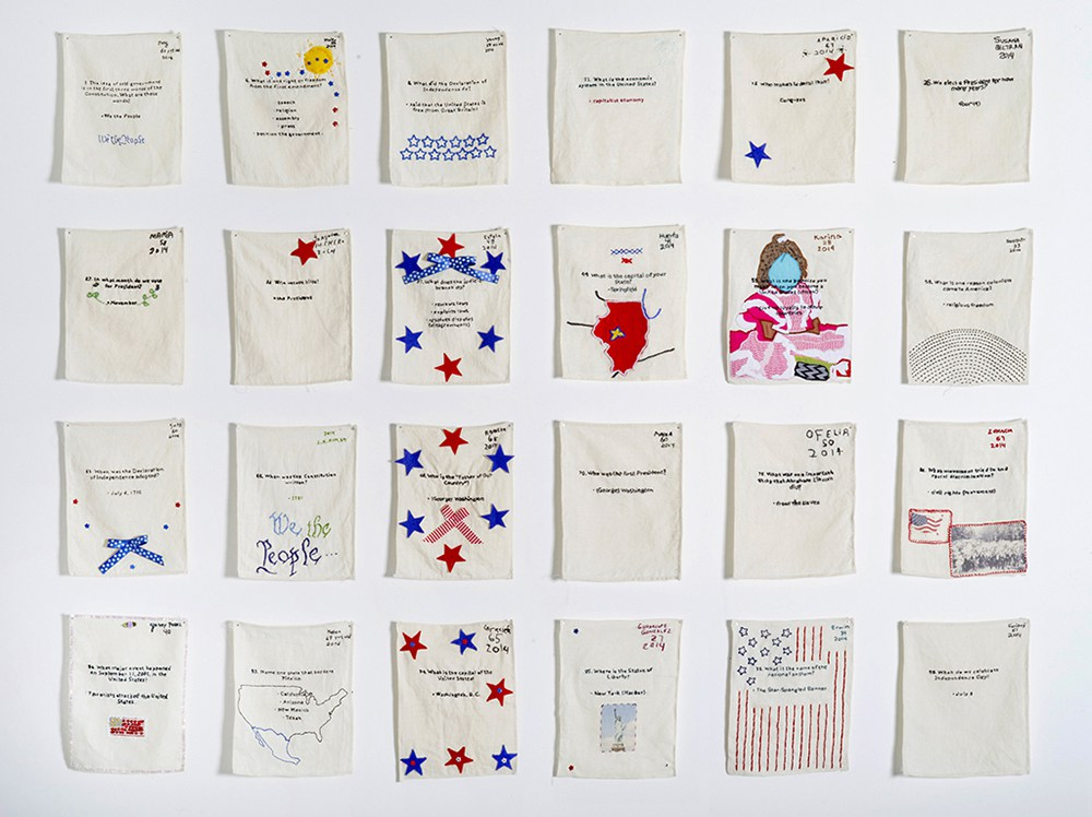 """""""US Citizenship Test Sampler"""" (24 out of 120), 2013–present. Embroidered samplers made by non-citizens who live and work in the U.S. installed in a grid format. Photo by Hyounsang Yoo."""