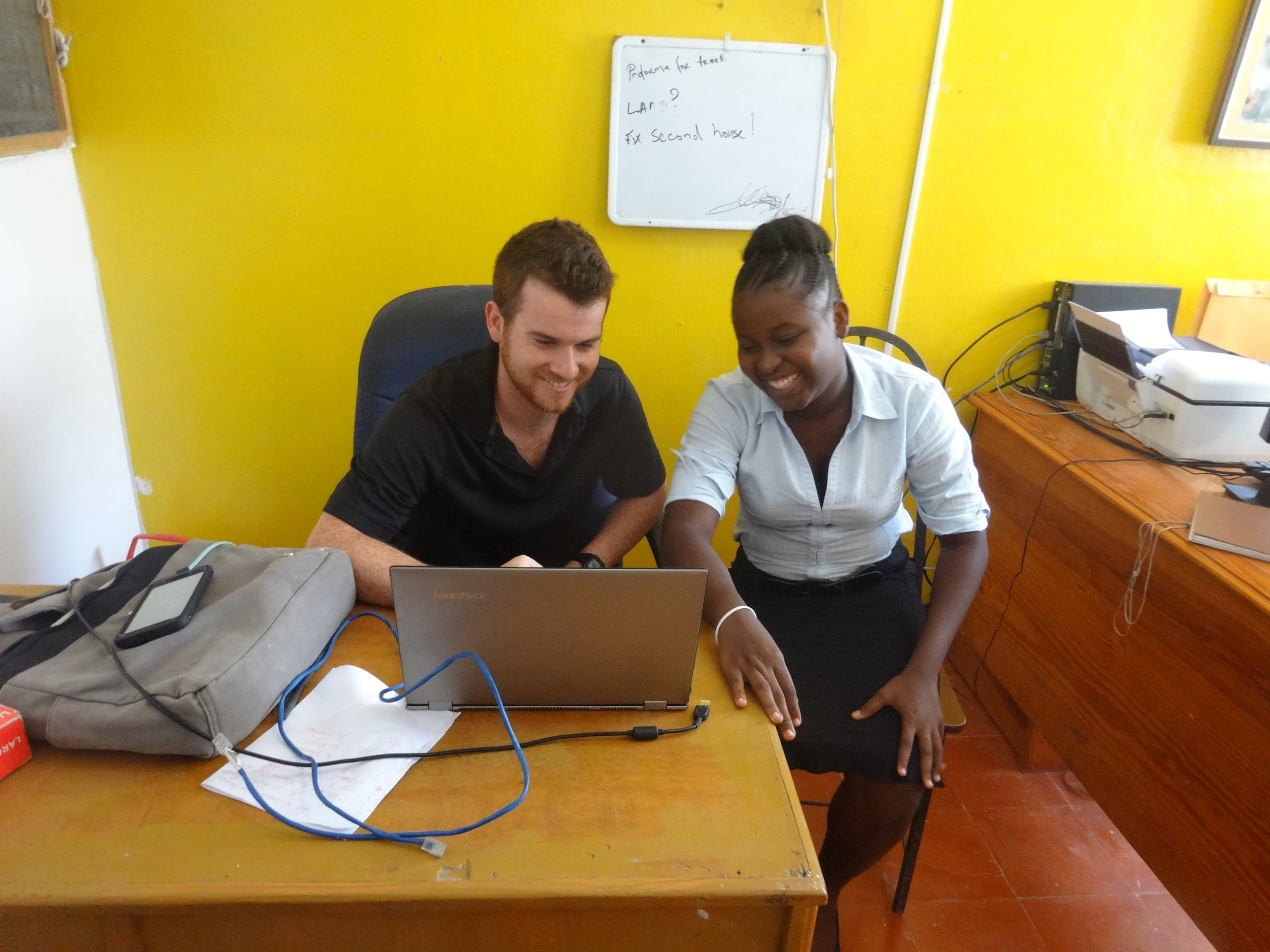 In-country Program Manager Connor Branham works in THP's Office of External Affairs with accountant and LCS alumna Stephanie Valcourt.