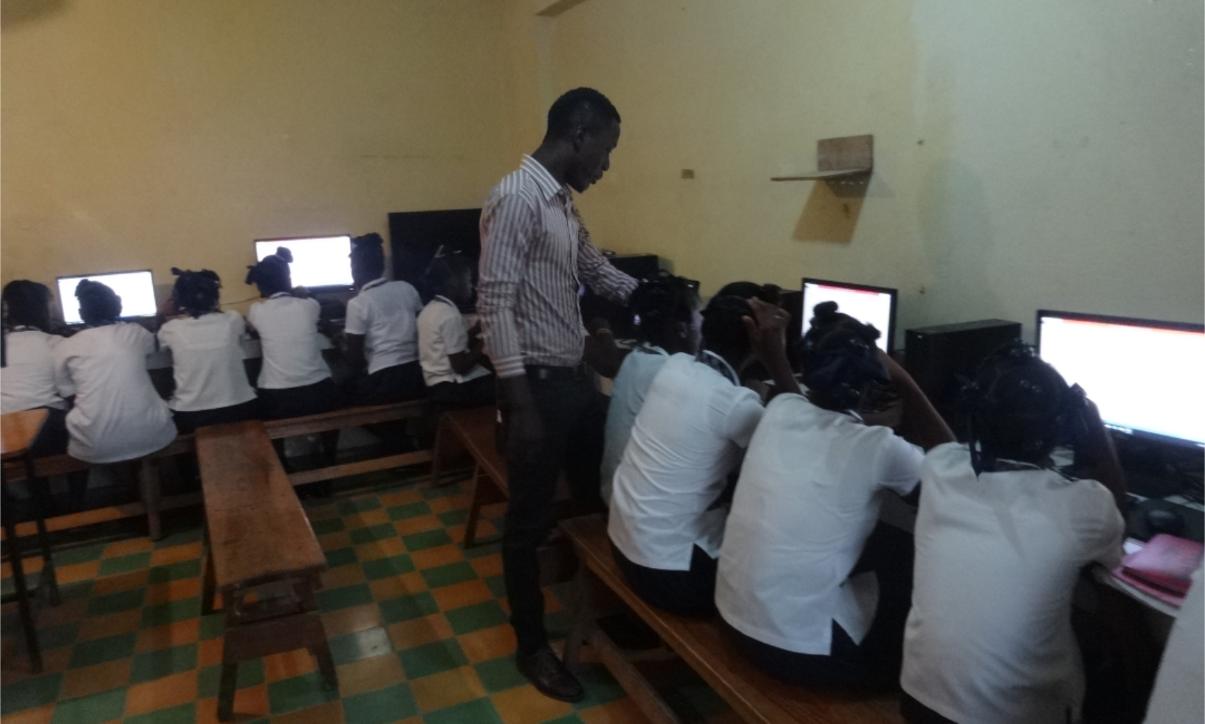 Jeff Benoit (LCS '14), head of the LCS Computer Department, teaches students in the brand new computer lab donated by the Michael and Susan Dell Family Foundation.