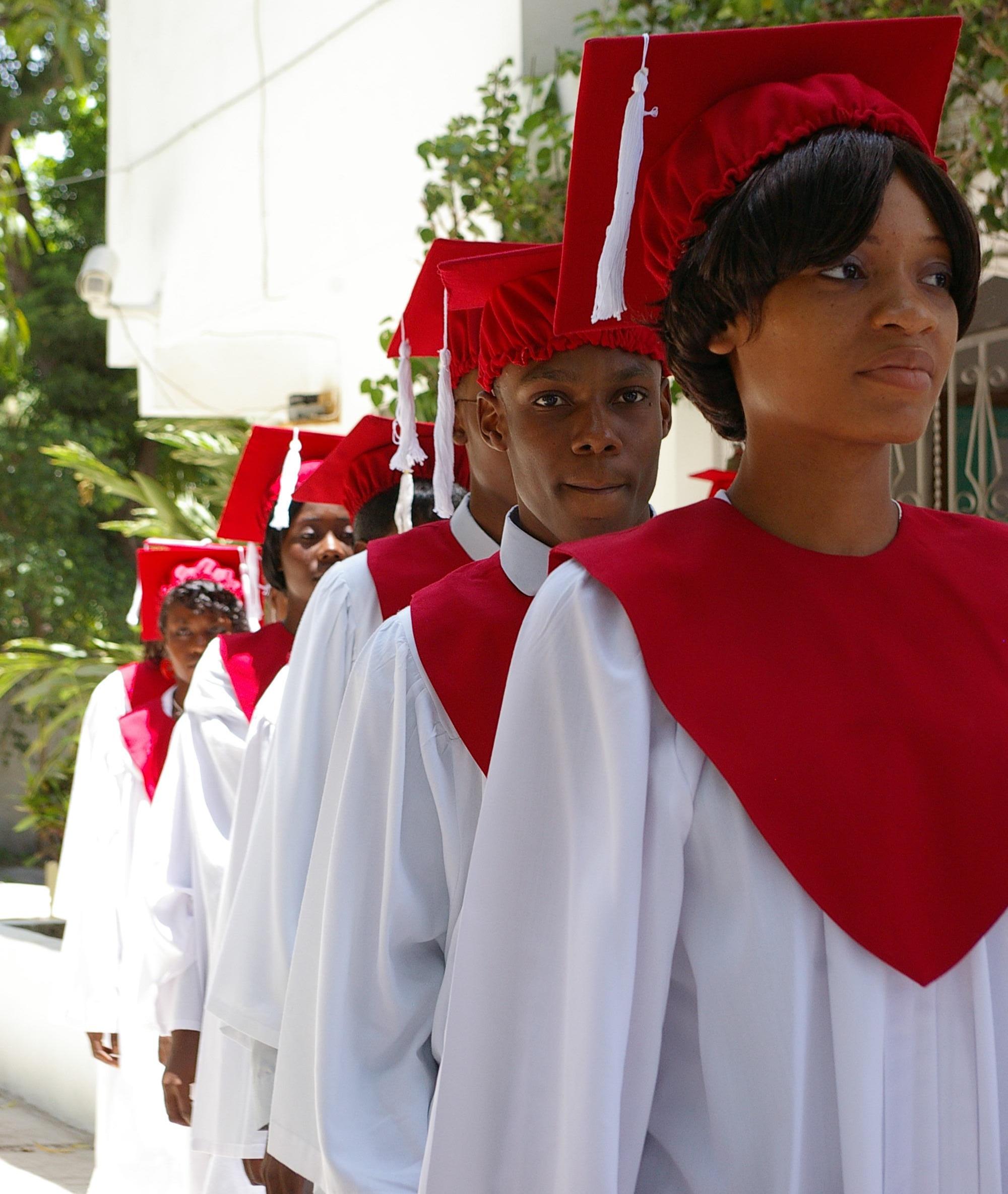 TheHaitianProject Graduates Walking.png