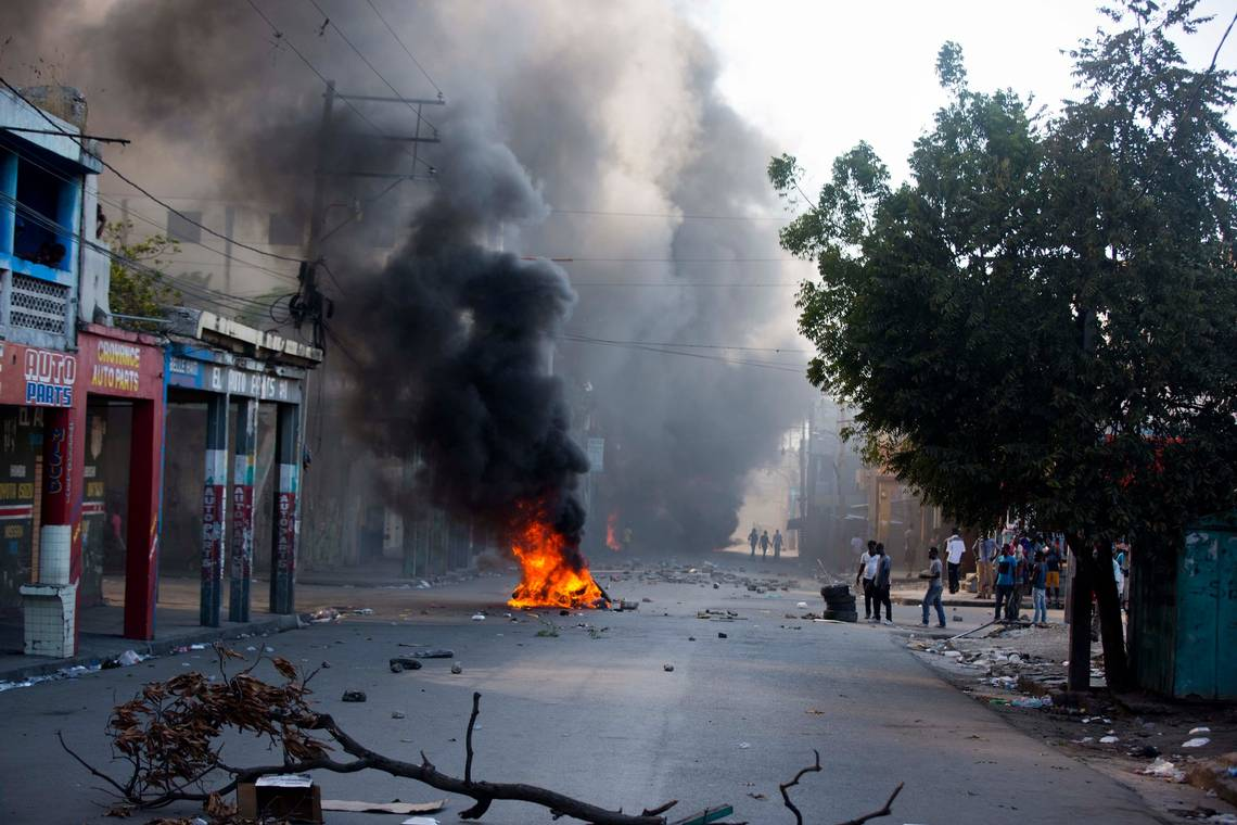 Black smoke billows from burning tires during a protest on Saturday, February 9, 2019, in Port-au-Prince, Haiti. Photo credit: AP Photo/Dieu Nalio Chery