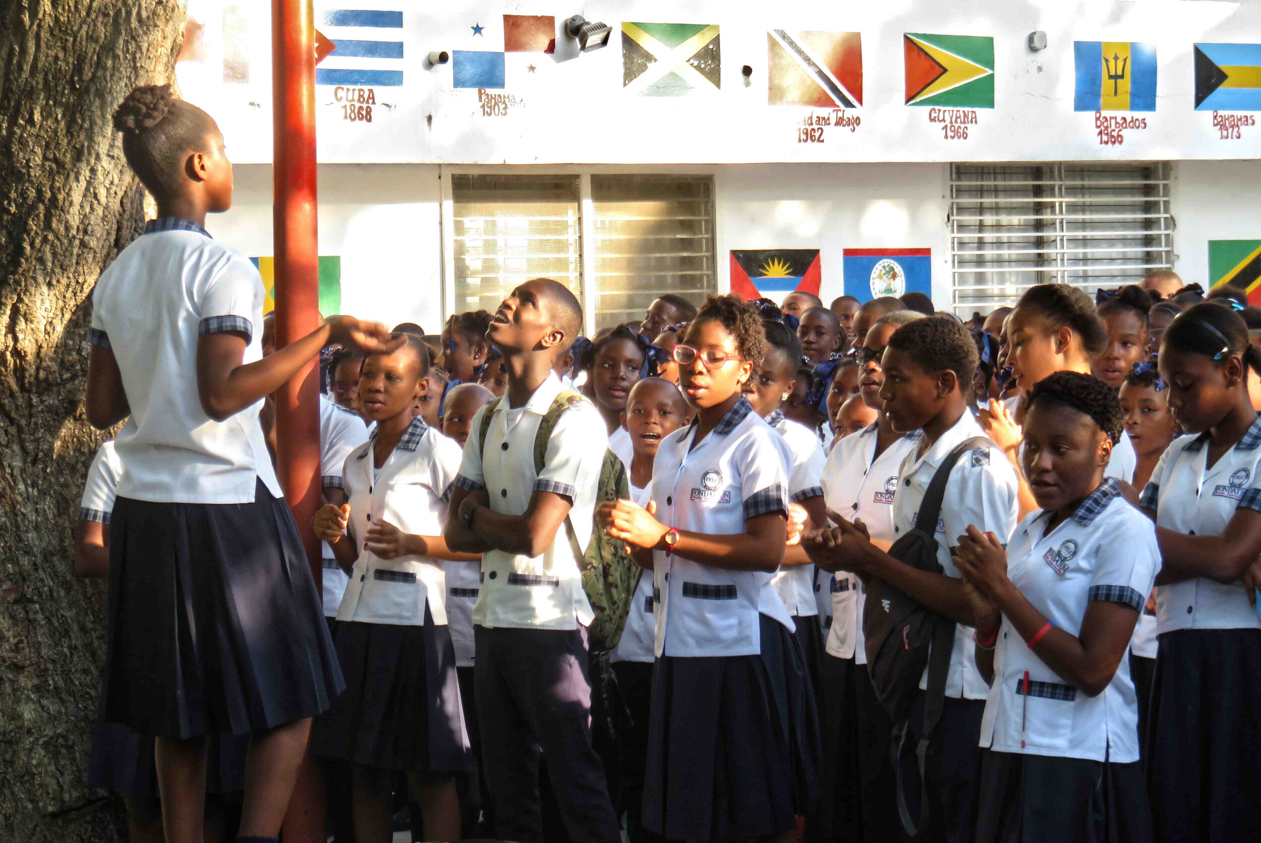 LCS students sing the school song—The Louverturian—on the opening day of school.