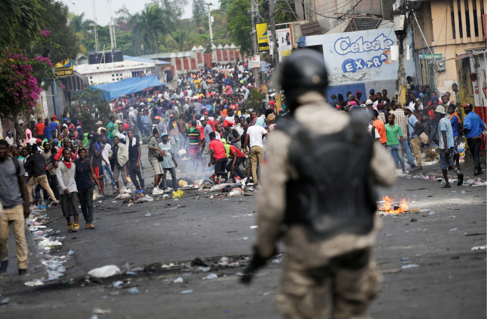 Demonstrators in the streets of Port-au-Prince. Photo credit: Andres Martinez Casares/Reuters