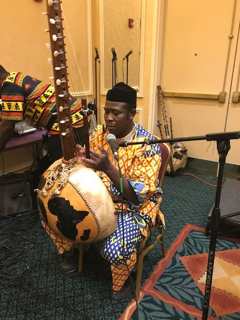 Musician Roland Kemokai performs at the U.S. - African Business Investor Conference
