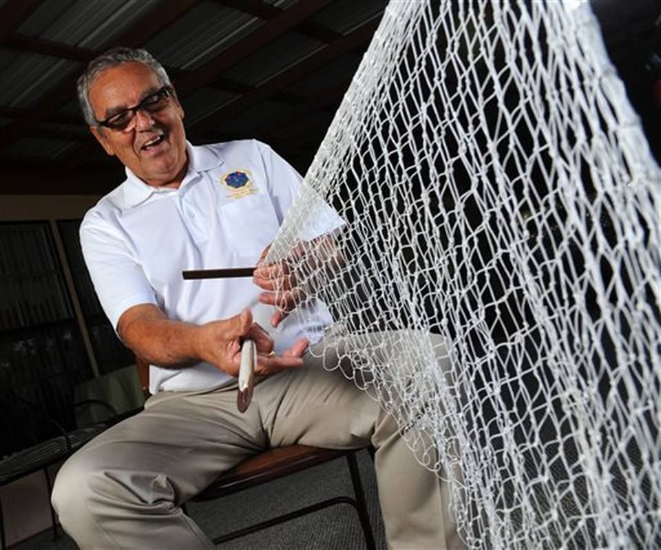 Mike Usina of Minorcan Magic hand making a cast net. Be sure to visit him at his booth at  Made in St. Augustine  to watch him work his magic!