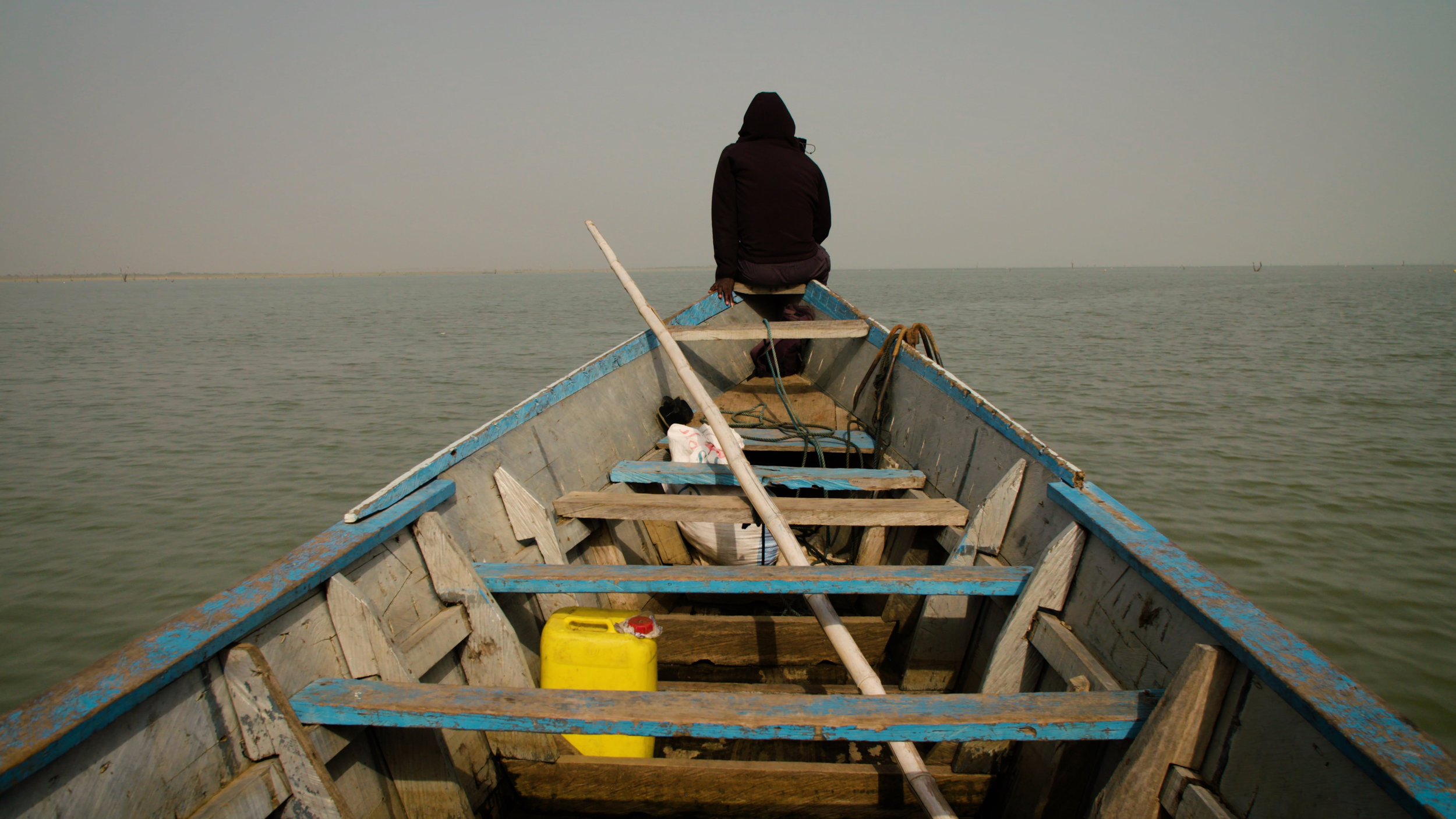 Kwame on the bow of rescue boat.jpg