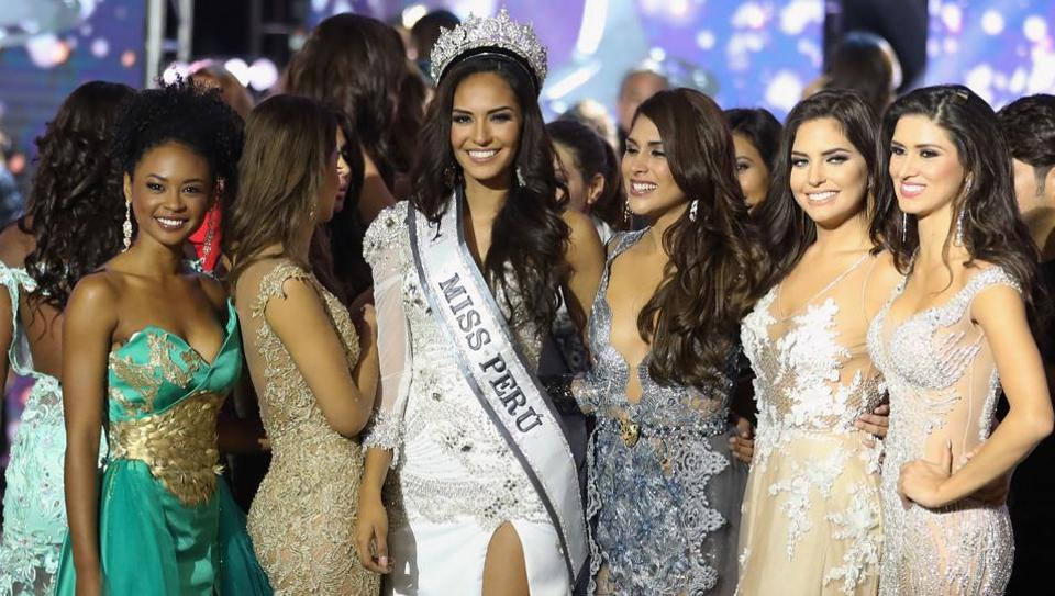 """Pageant winner, Romina Lozano (middle), from the province of Callaomy, gave her measurements as;  """"3,114 women victims of trafficking up until 2014."""" Source:  story-eqhZr5LW7CCIf1luxP4gDO.html"""