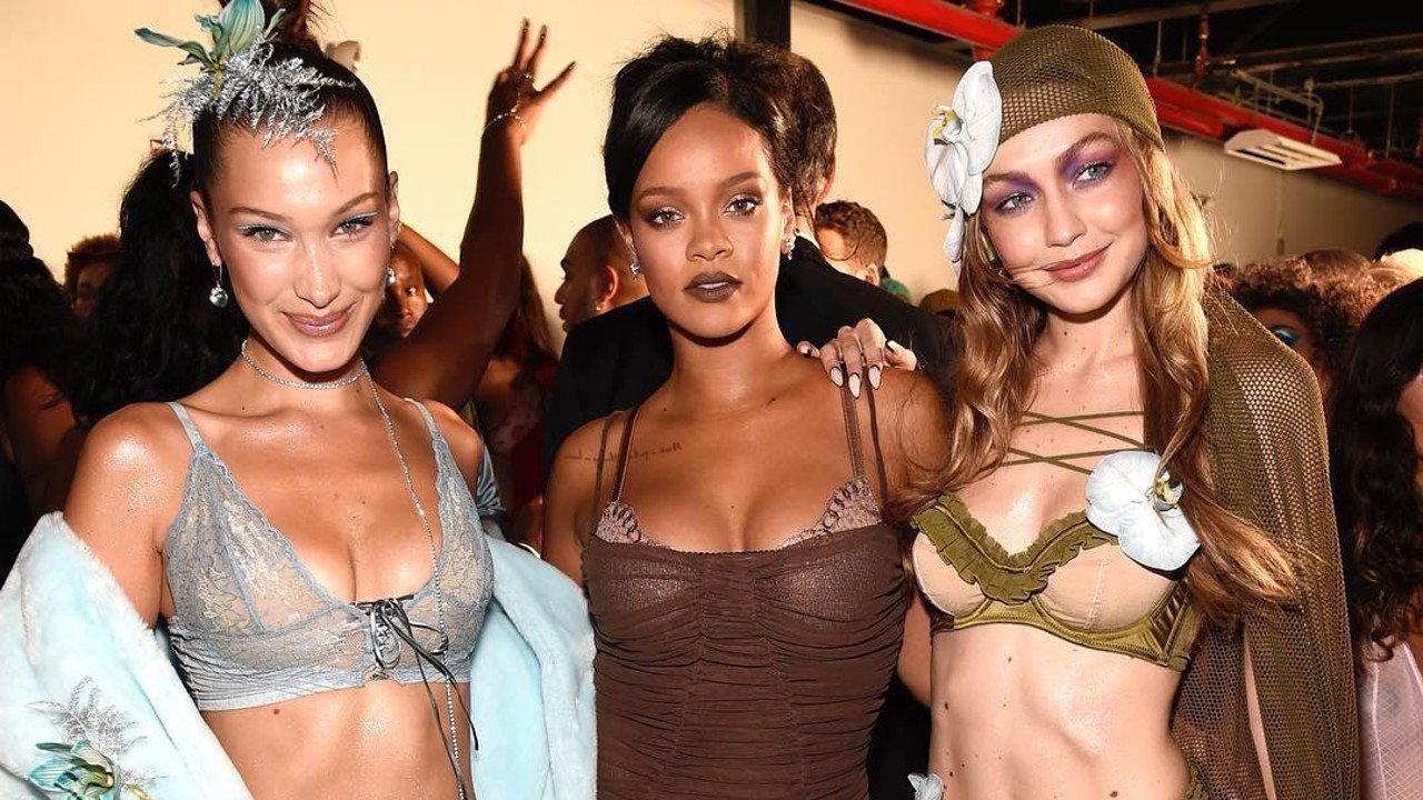 Rihanna (centre) sandwiched by the Hadid sisters (Left; Bella, Right; Gigi) at her Savage X Fenty lingerie show at NYFW. (Source:  South China Morning Post)