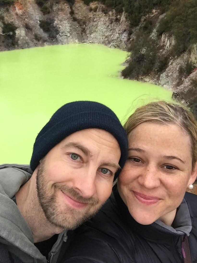 Caitlin and her husband near the green lakes of Rotorua (Photo Credit: Caitlin Rovner)