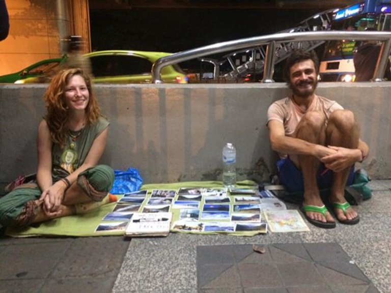 """Beg-Packers"" selling postcards on a street in Thailand"