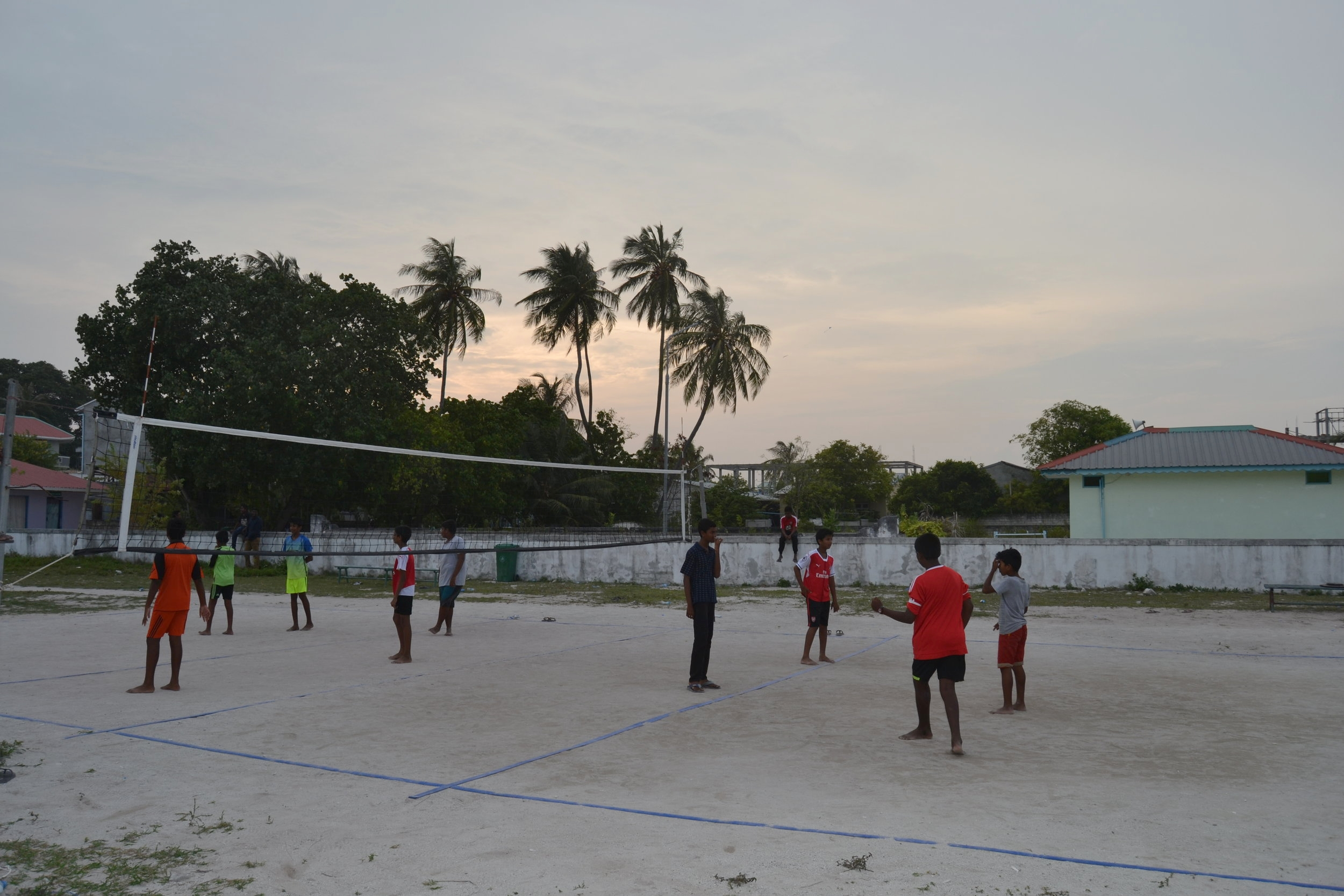 Locals playing volleyball on Huraa