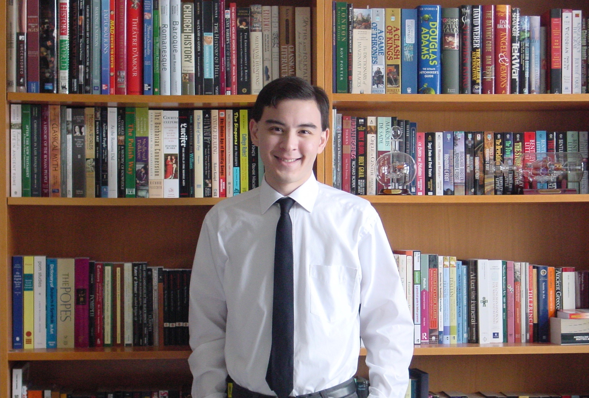 The author (age 22) with some books (2005)