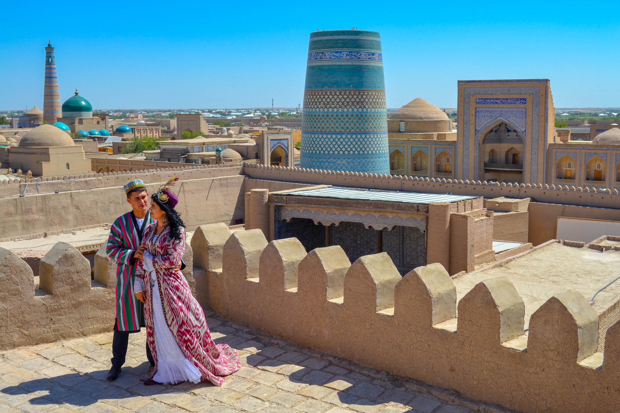 An Uzbek couple in Khiva posing for a wedding shoot