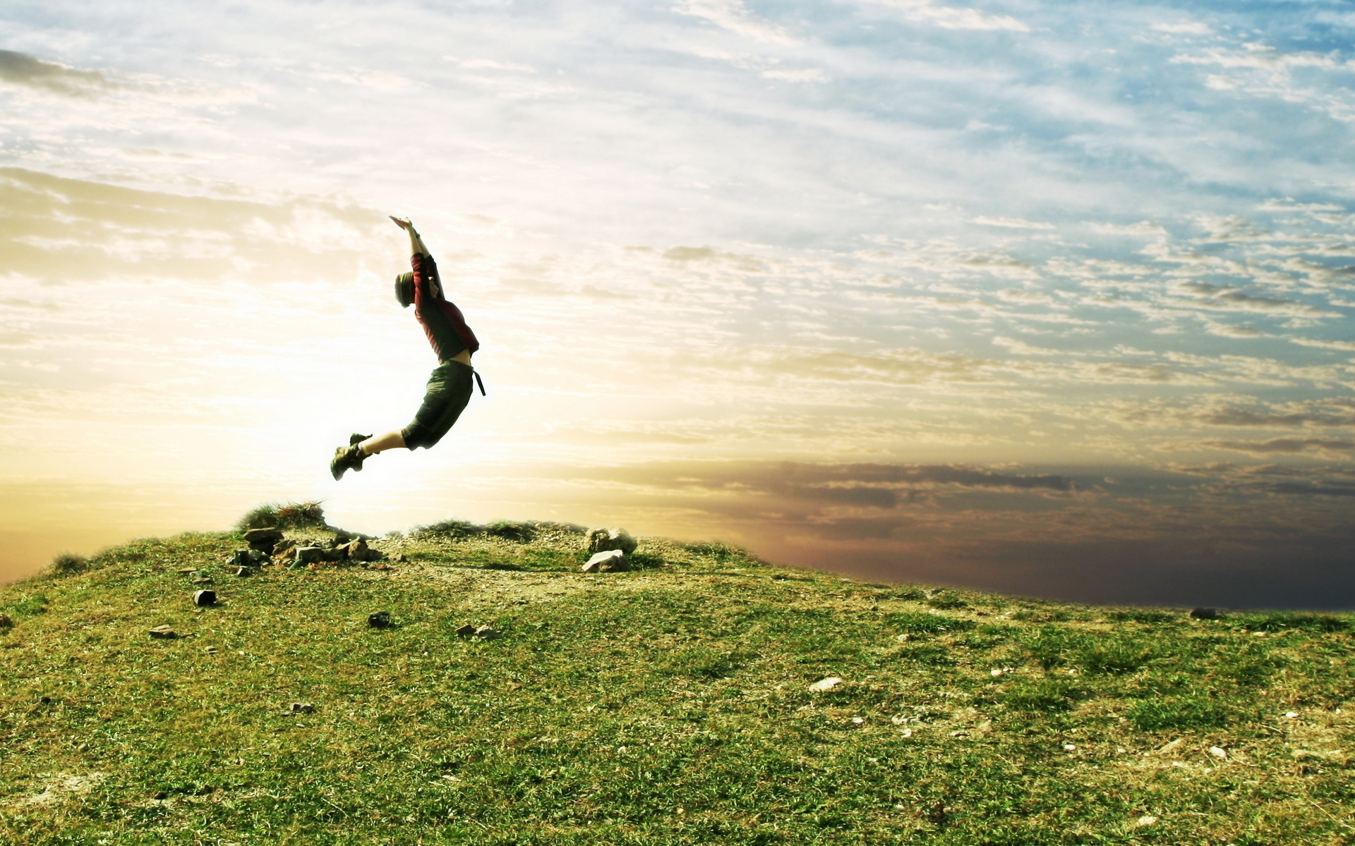 jump_people_field_grass_sky_nature_54406_1920x1200.jpg