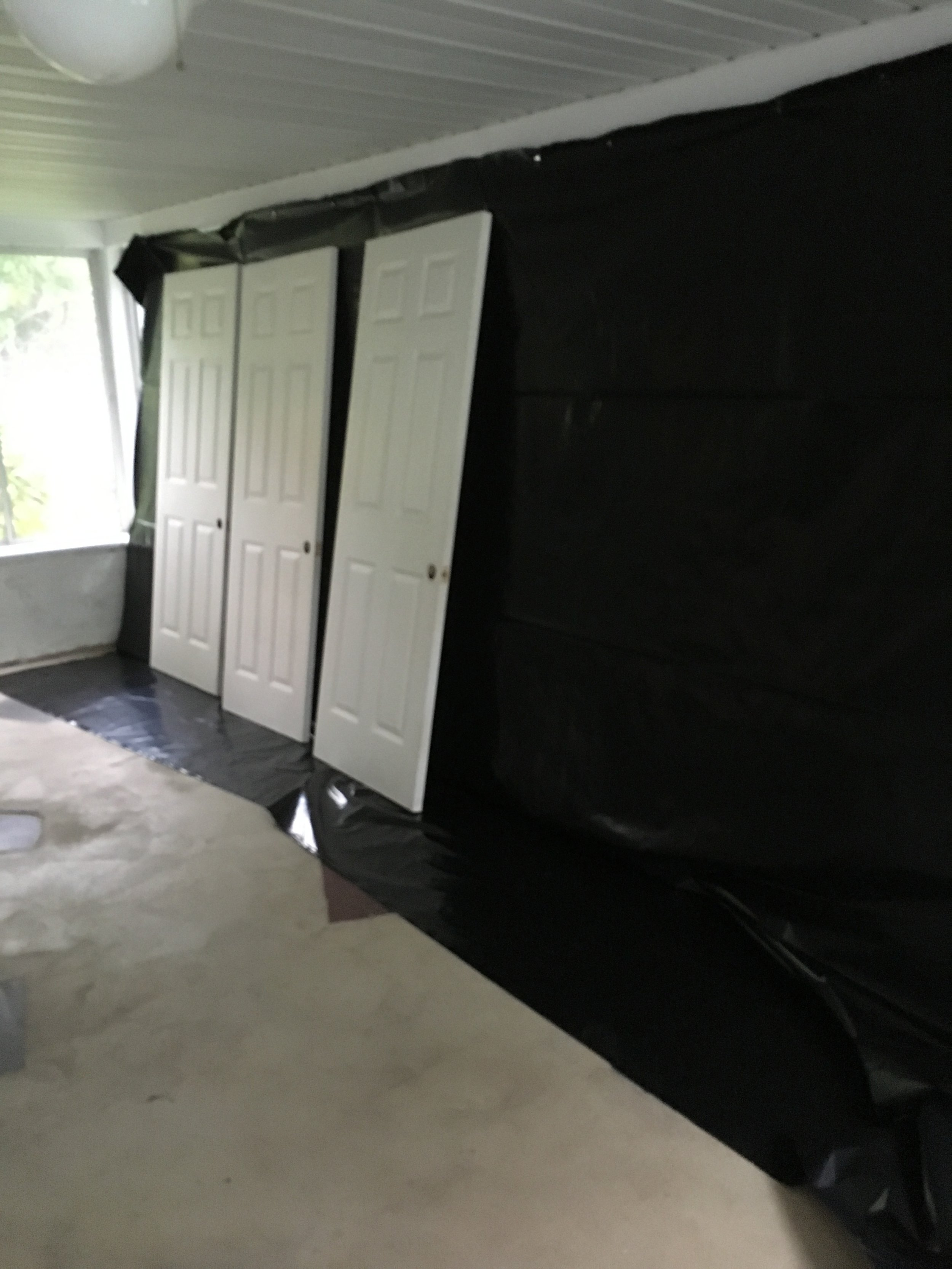 I was worried what the neighbors would think of us...from the outside it looked like we were making a black dungeon!! In reality, we were just trying not to inhale the paint fumes from the paint sprayer. You can see more of what the original floor looked like in this picture too.