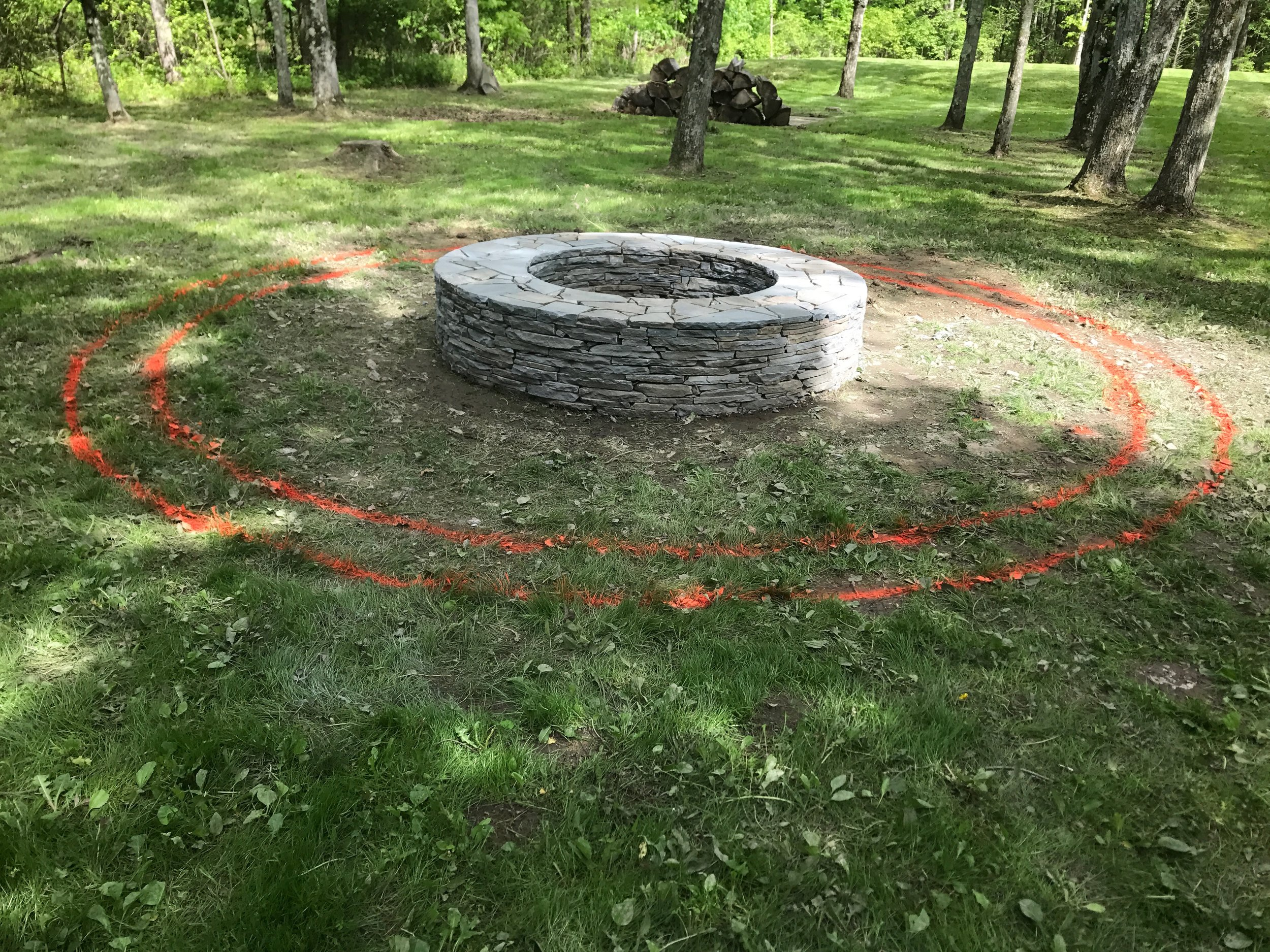 After the actual fire pit was complete, we realized that we needed some type of border to surround the pit and define the area.