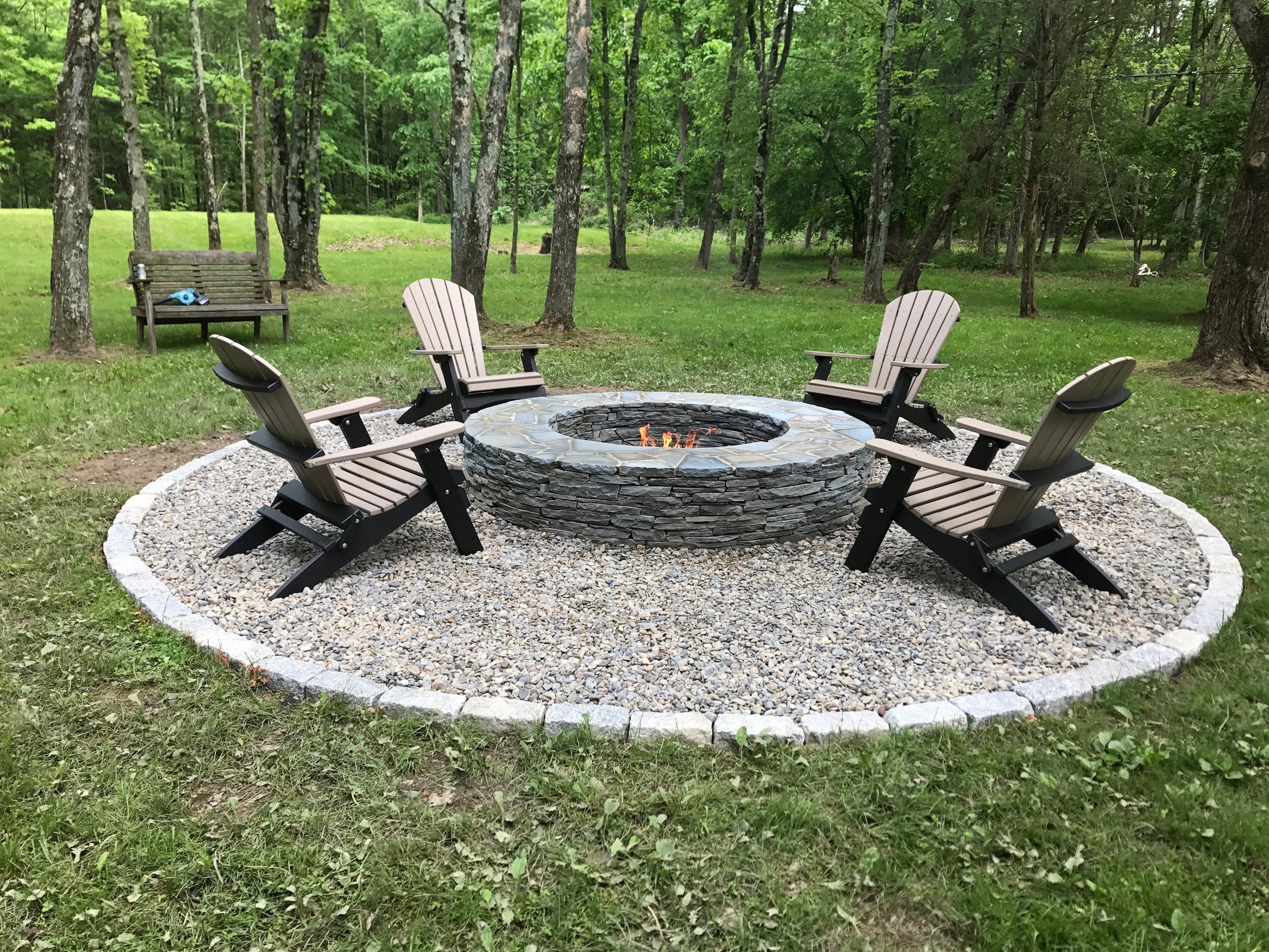 Once we had the Belgian block and river jack in place, we had a steady foundation to add some seating around the fire pit. We found the perfect poly wood chairs right around the corner! We purchased the chairs from   Country Wood Crafters   at their   Rice's Market   location. We think that the chairs really complete the fire pit area and love how the two-tone colors are a little different than what you would expect to see with a traditional Adirondak style chair.
