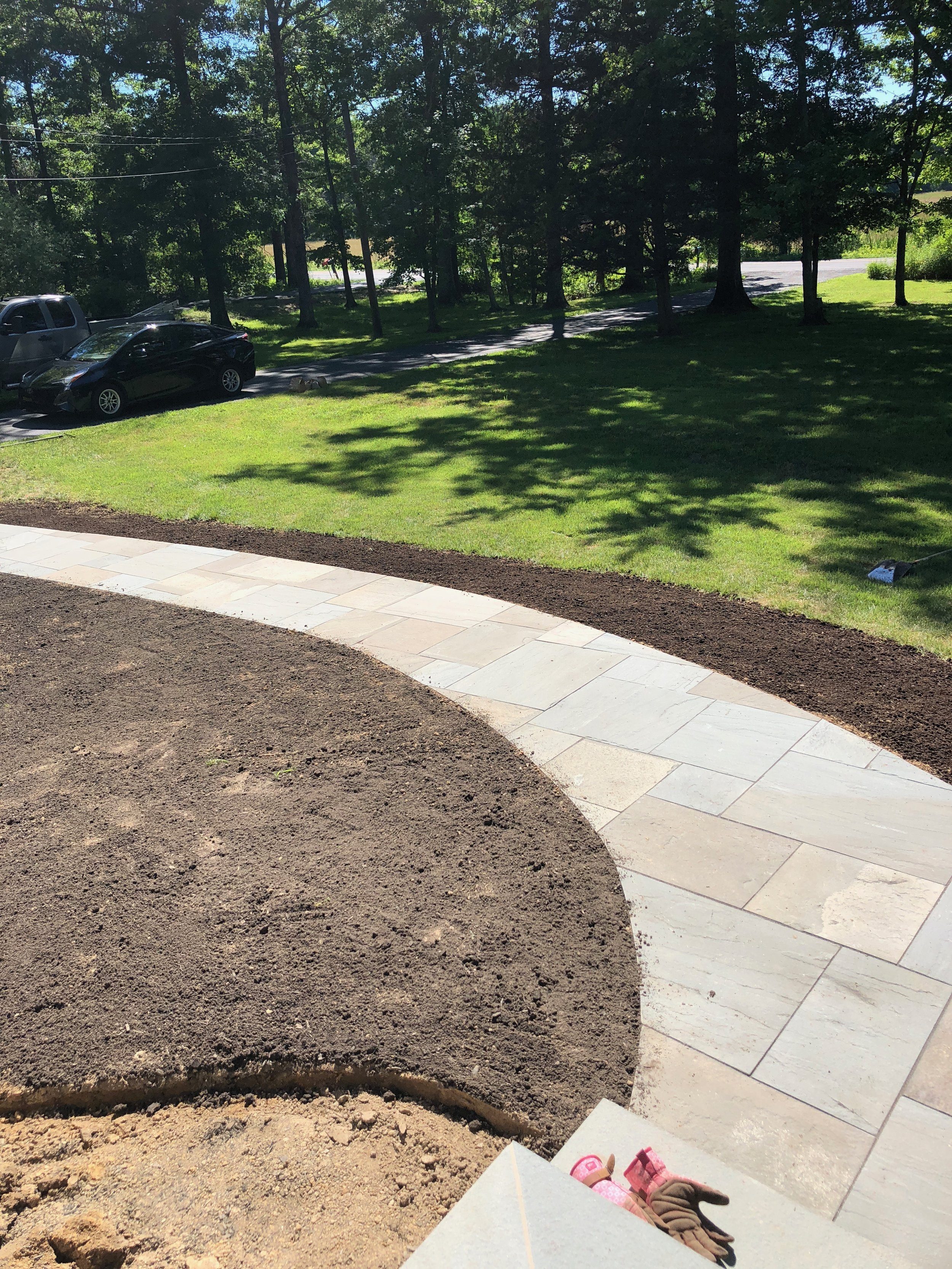 After the walkway was complete, the final step was grading the lawn. We added topsoil and planted grass seed so the walkway would blend seamlessly into the existing lawn.