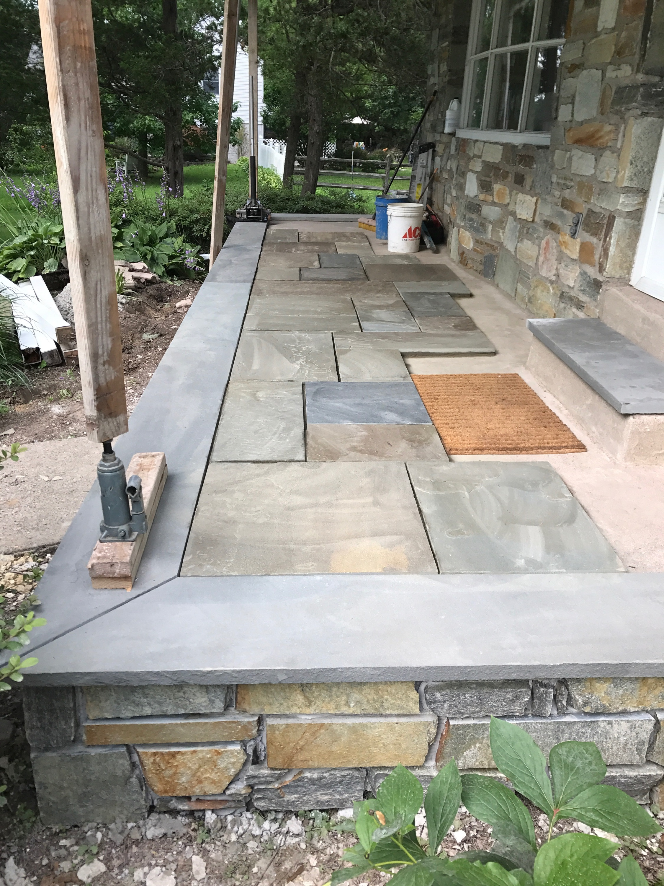 After the stone was added to the sides, we added a bluestone tread border with random pattern bluestone in the center.
