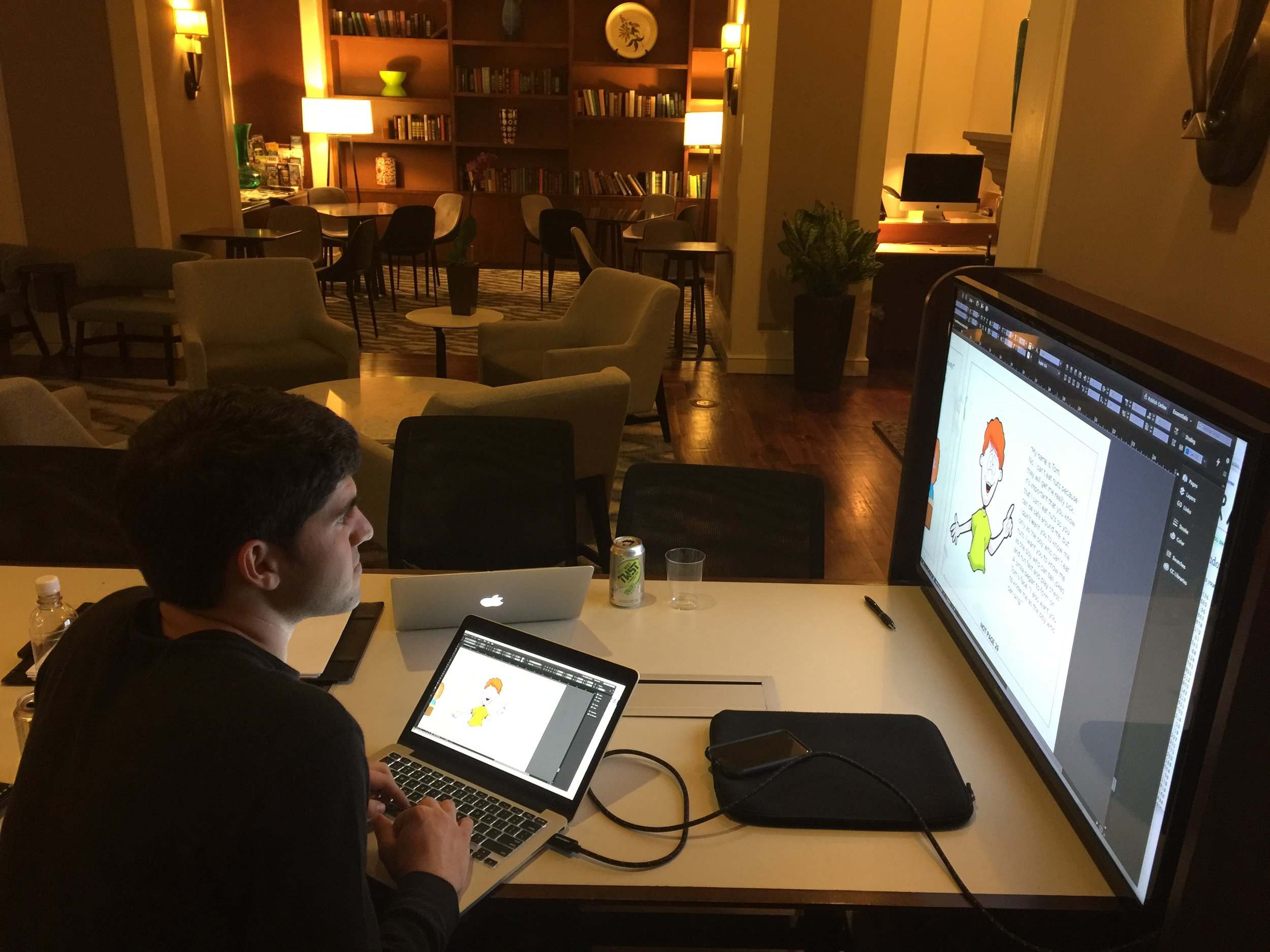 JJ is formatting the  Land of Not in the lobby of the Club Quarters Hotel in Philadelphia before the first printing.