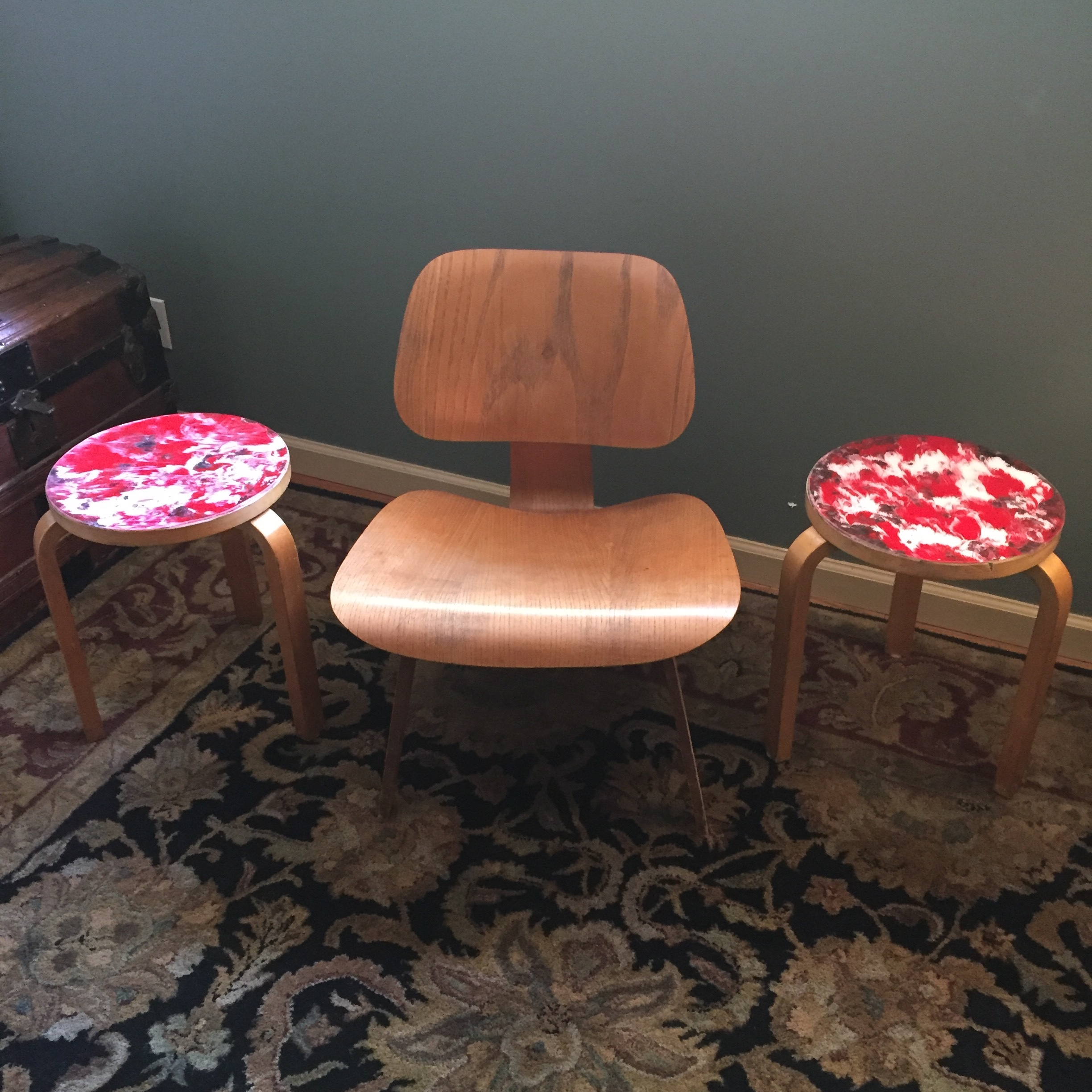 Painted vintage Alvar Aalto stools paired with original Eames LCW