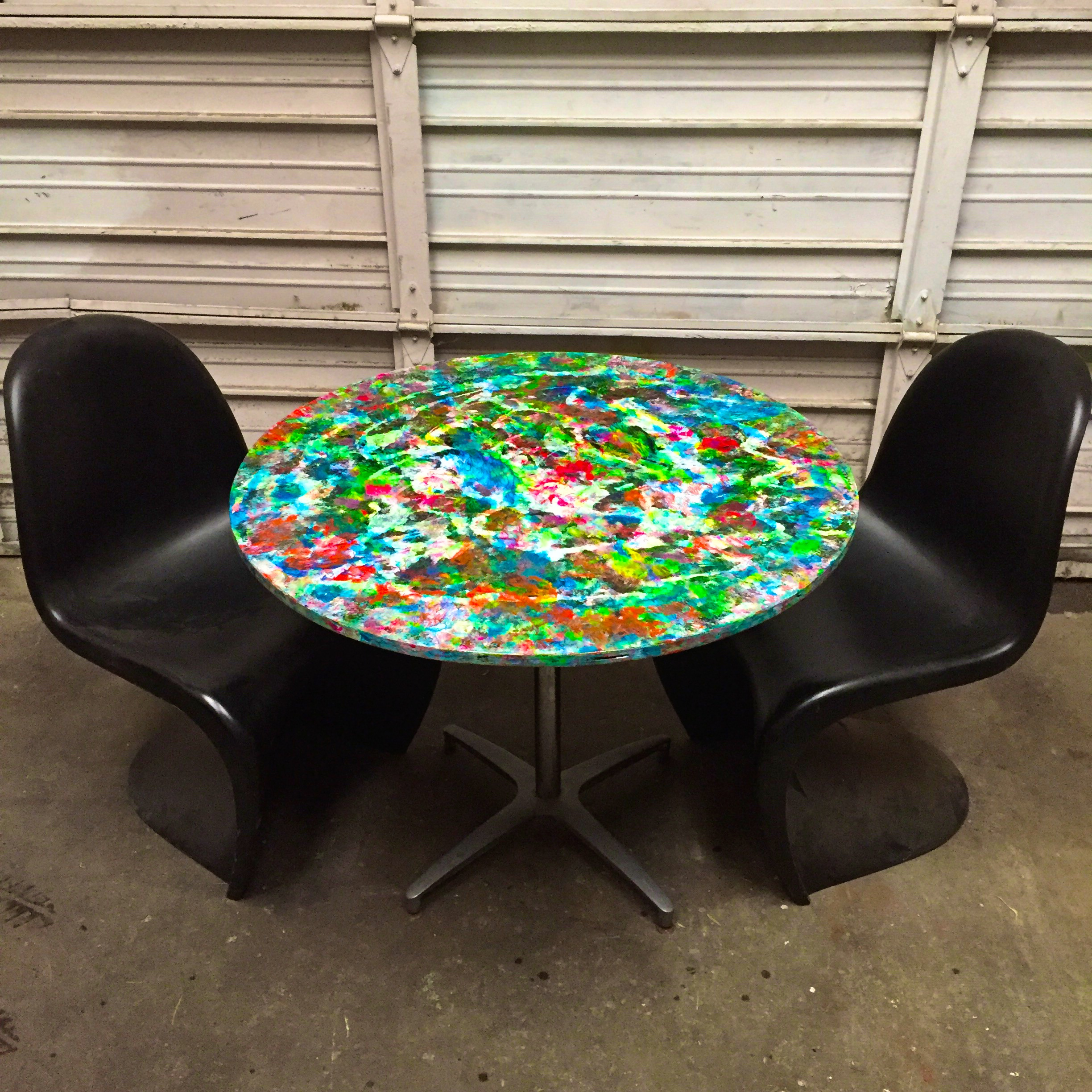 Painted table with Vernor Panton chairs