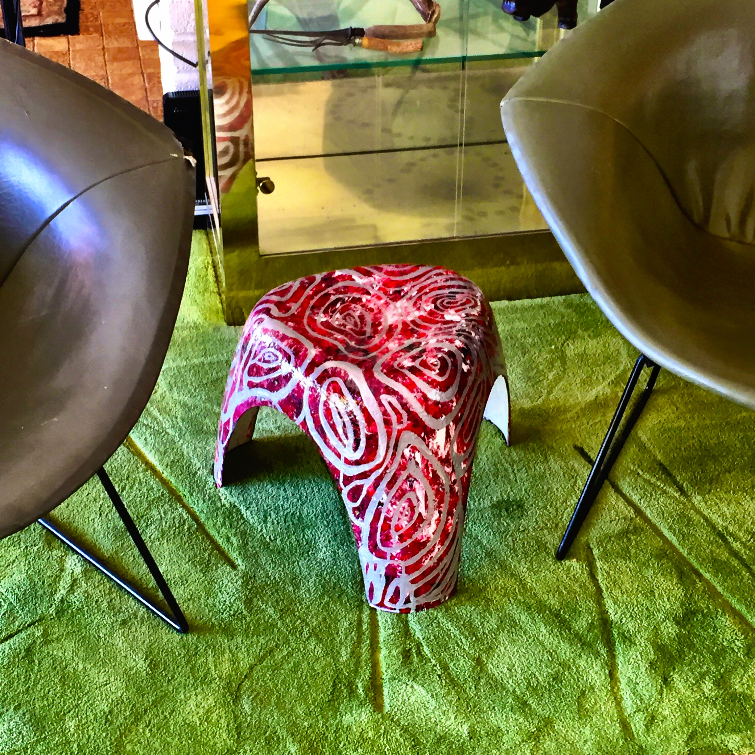 Painted elephant stool with Bertoia chairs