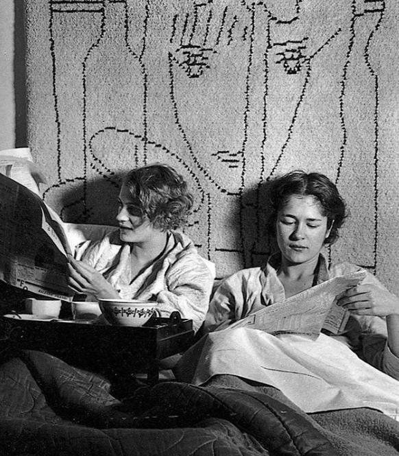 Lee Miller and Tanja Ramm having breakfast in bed at Lee's Paris studio, 1931