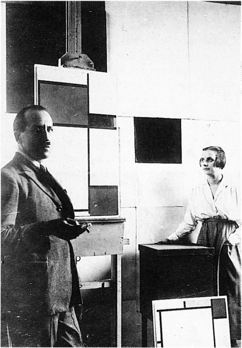 Piet Mondrian in his studio with Pétro van Doesburg