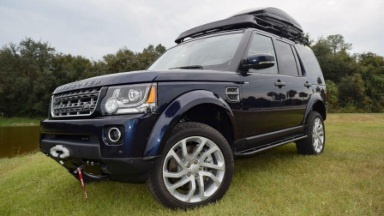 Land-Rover-LR4-hidden-winch-mount-skid-plate-rock-sliders-standard-off-road-roof-rack-molded-wind-fairing-Thule-box-Voyager-Offroad.jpg