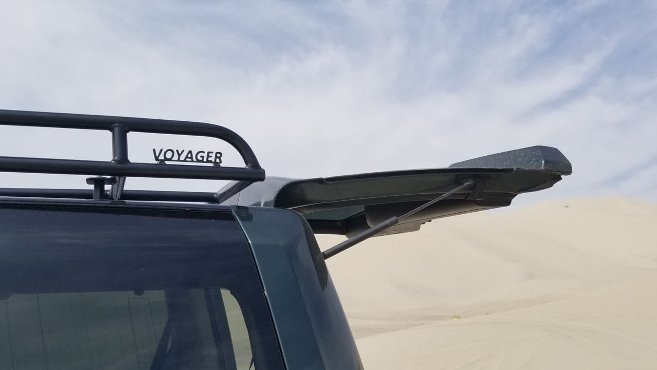 Land-Rover-LR4-off-road-high-desert-sand-trunk-open-Voyager-low-profile-roof-rack-Voyager-Offroad.jpg