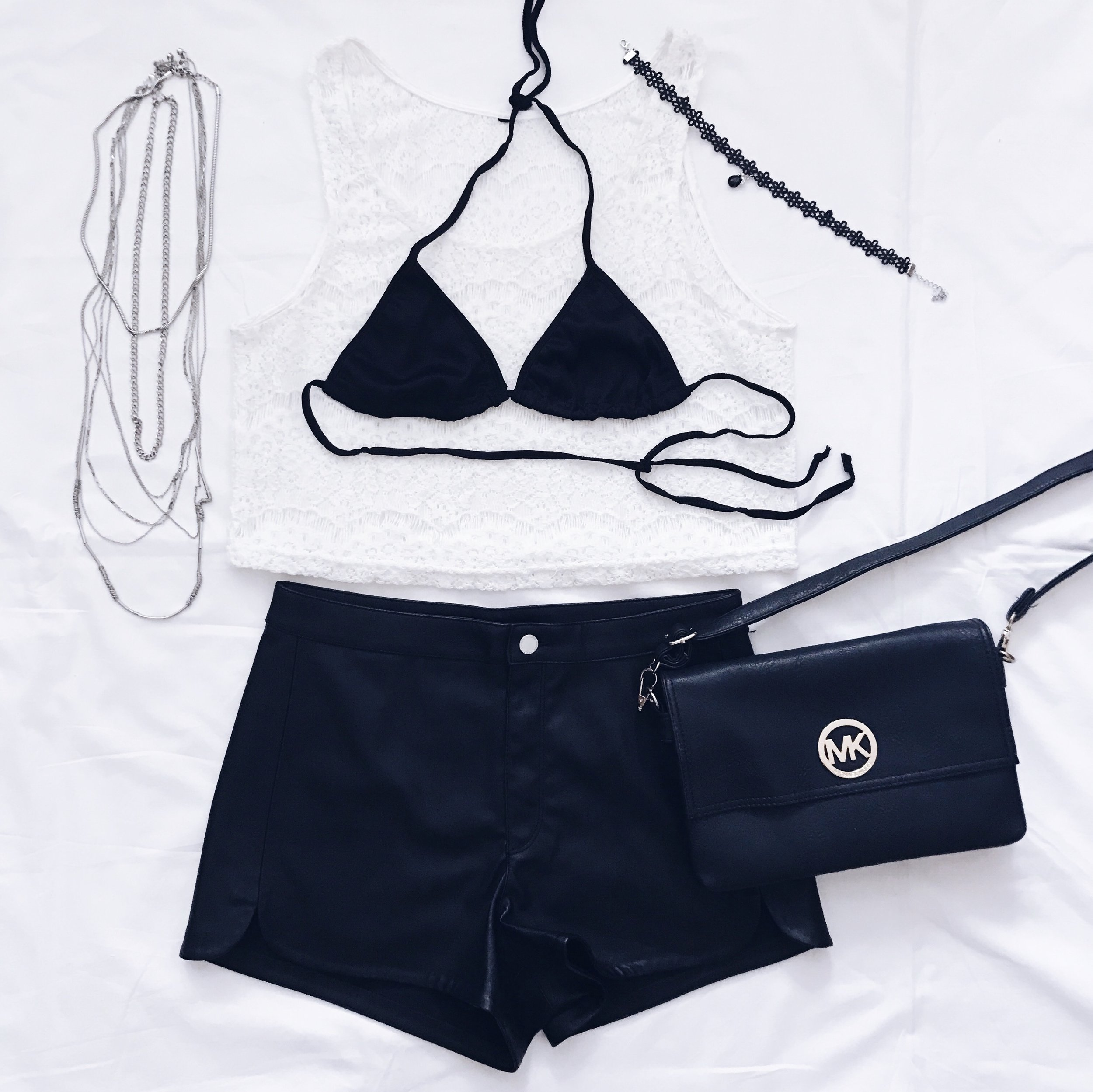 White Lace Crop Top: Terranova     Leather Shorts: H&M    Crossbody Bag: Michael Kors    Bikini Top: Asos    Necklace Set & Chain Necklace: H&M    Lace Crystal Choker: Amazon Fashion