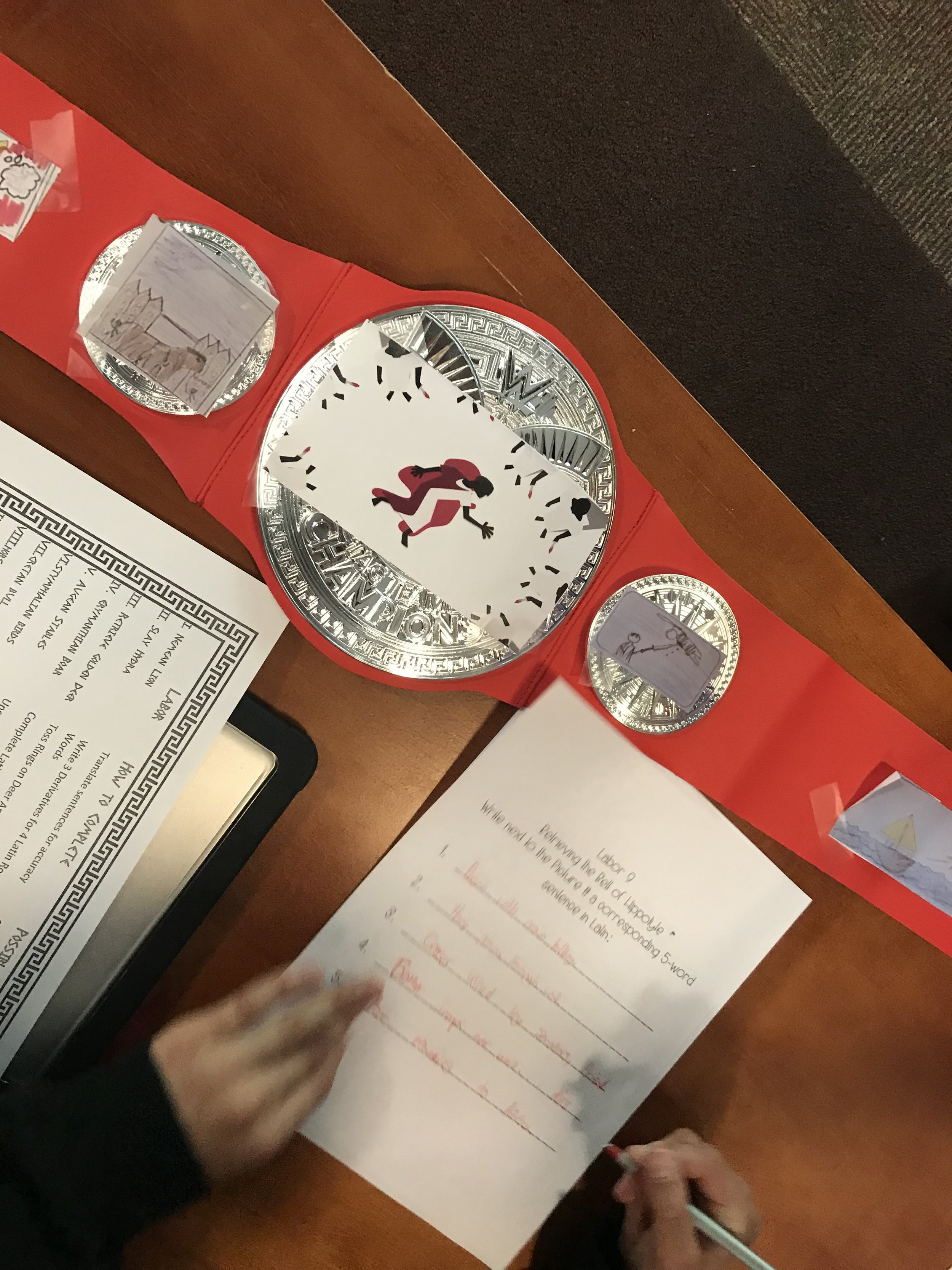 Belt of Hippolyte:  Students described pictures taped to a WWE belt by composing Latin sentences.