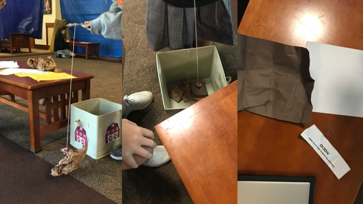 """Students """"cleaned"""" stables by unscrambling words which were on brown paper fished from the stable (box)."""