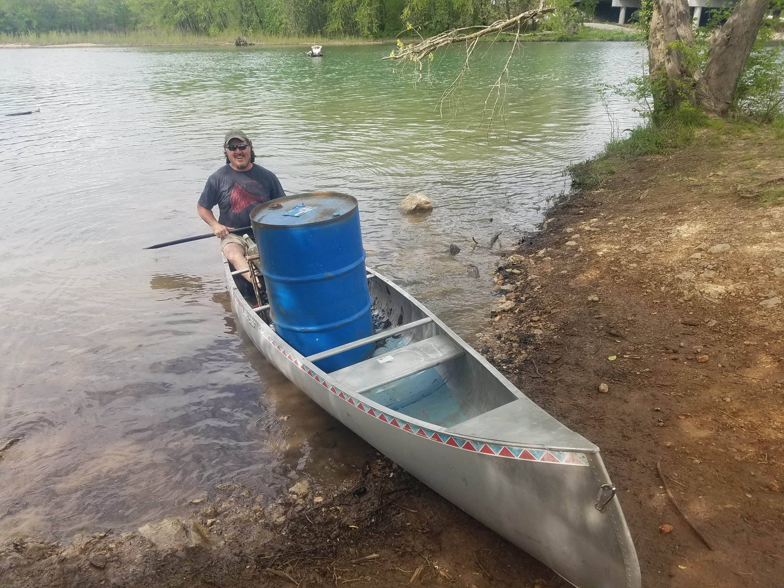 JRBP member Greg Fehrenbach brings in the blue barrel at the Earth Day cleanup on Lake Springfield.